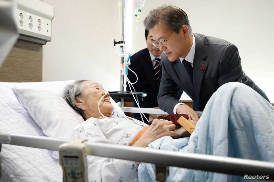 "South Korean President Moon Jae-in meets with South Korean Kim Bok-dong, who was abducted to serve as a ""comfort woman"" for wartime Japanese soldiers, at a hospital in Seoul, South Korea."