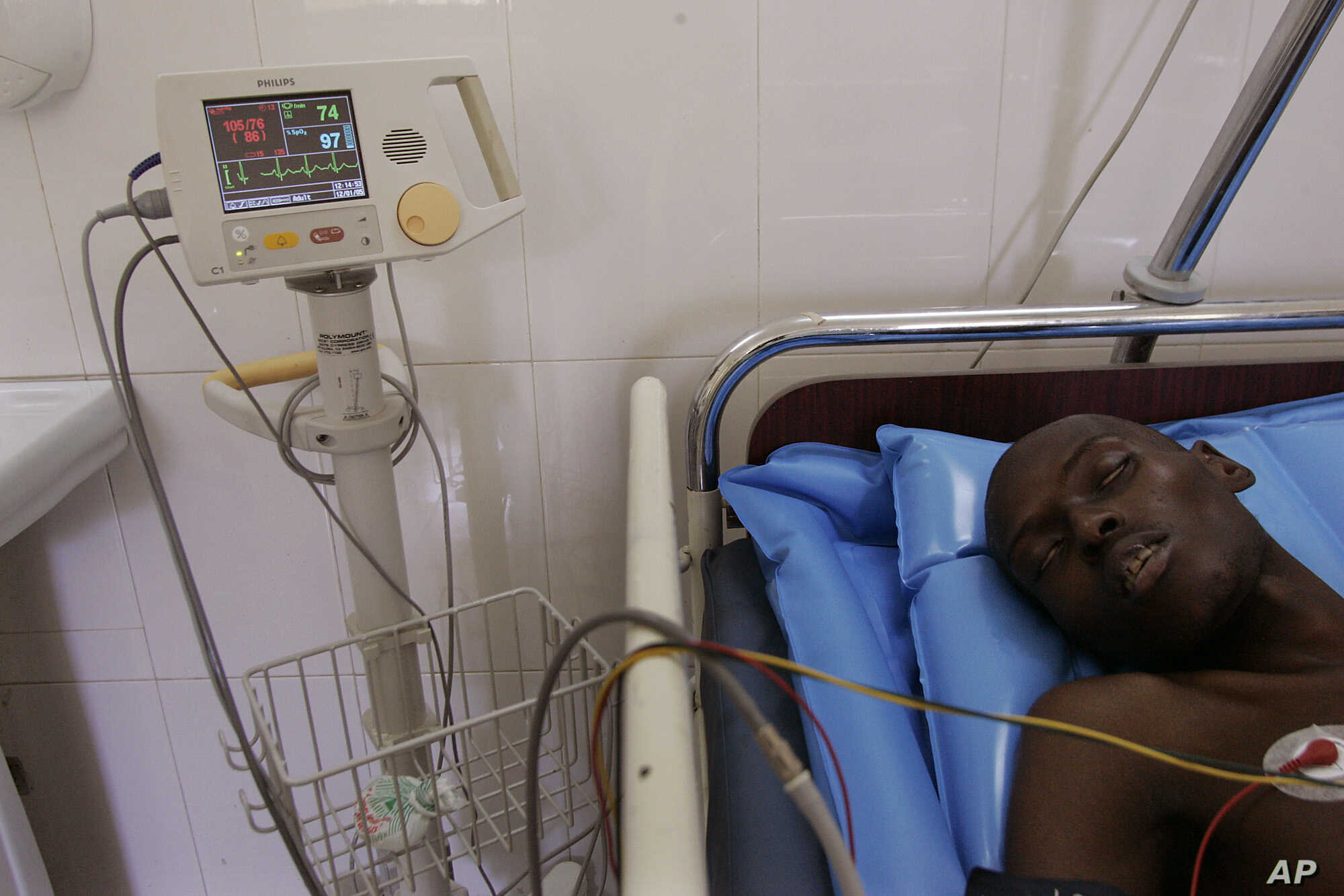 A man, who did not want to be identified, lies in a ward that specializes in the treatment of Aids at a hospital in Dakar, Senegal Thursday, Dec. 1, 2005.