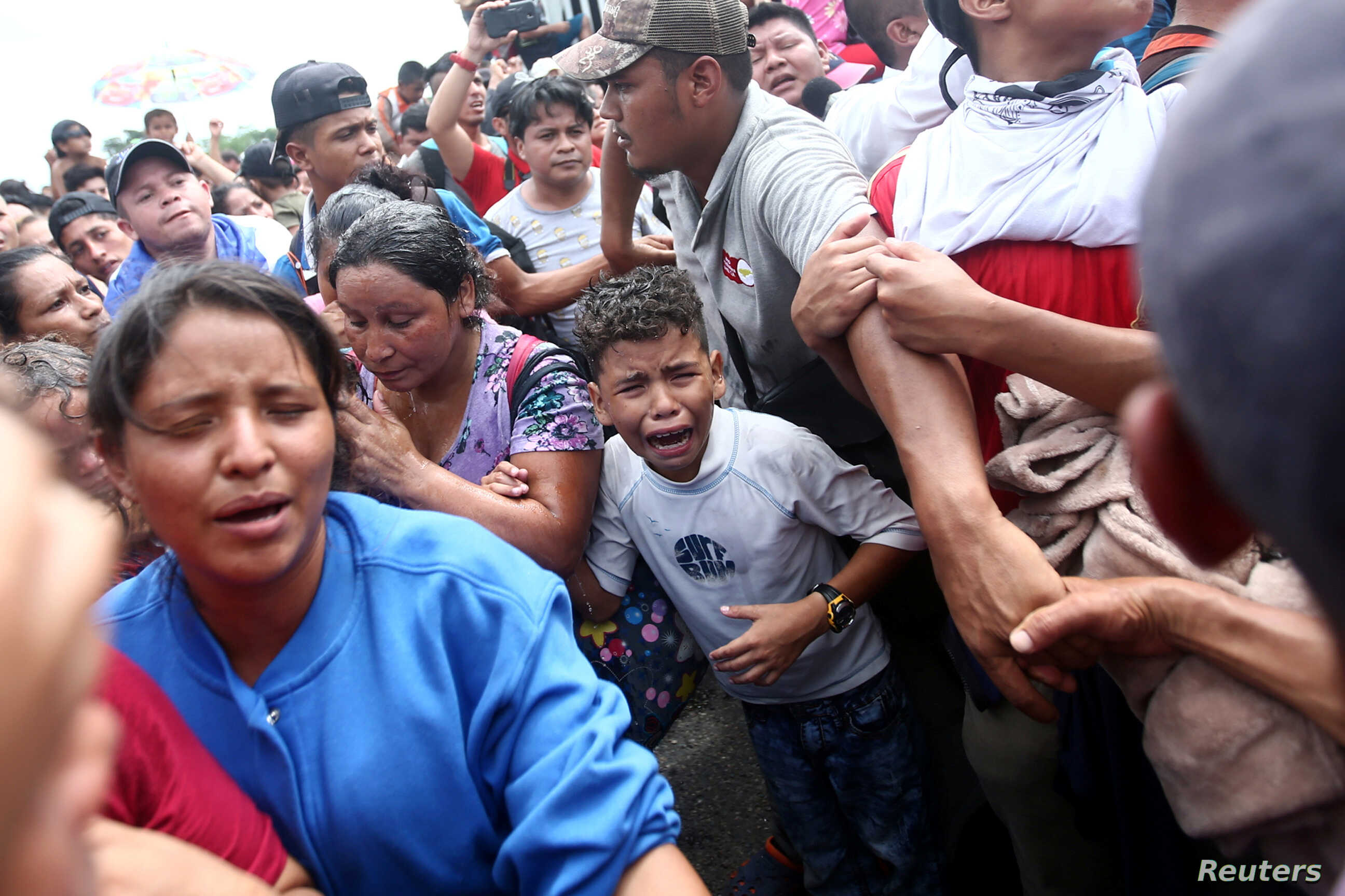 A Honduran migrant, part of a caravan trying to reach the U.S., cries after others stormed a border checkpoint in Guatemala, in Ciudad Hidalgo, Mexico, Oct. 19, 2018.