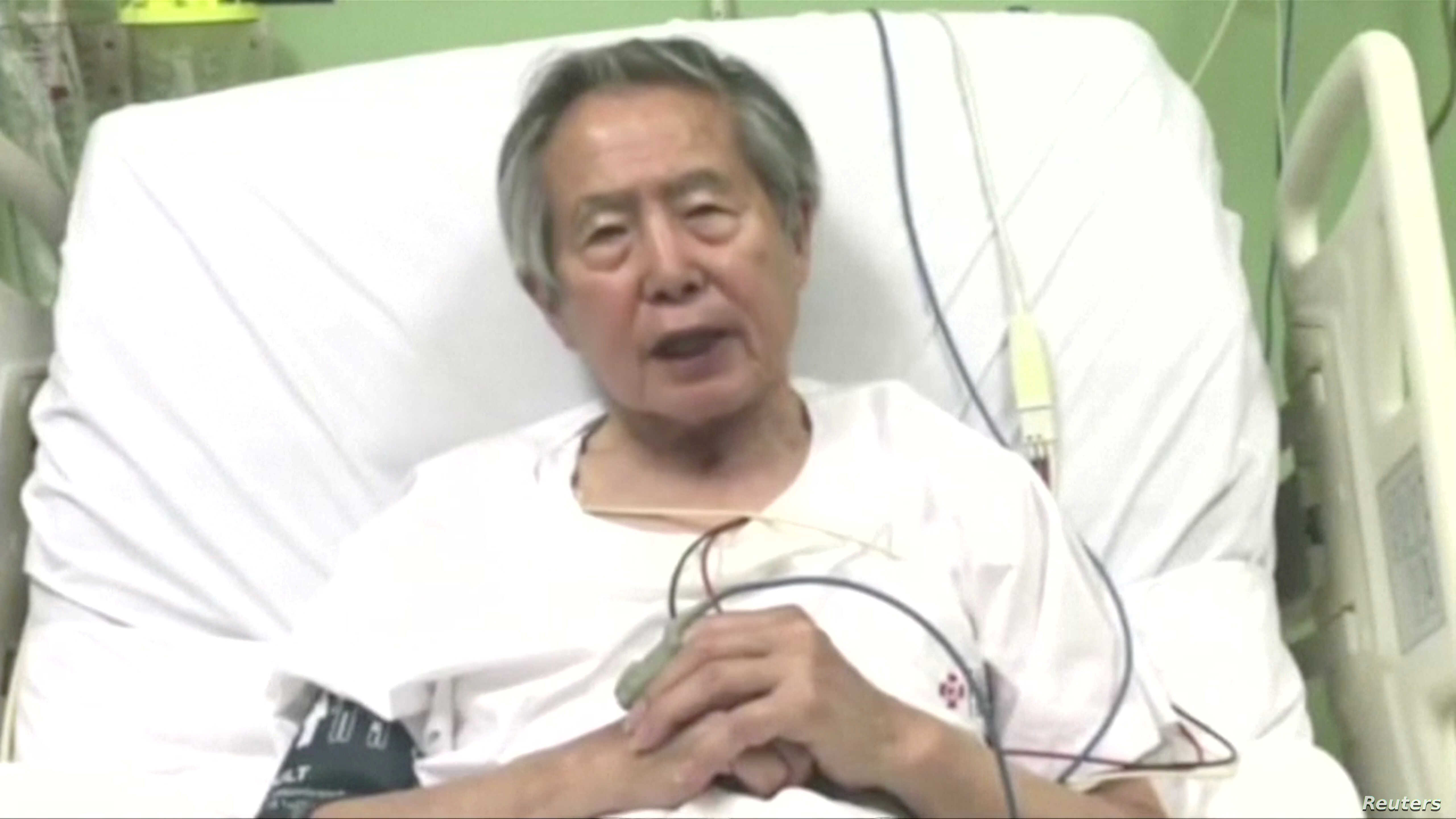 Peru's former President Alberto Fujimori asks for forgiveness from Peruvians as he lies in hospital bed in Lima, Peru, in this still image taken from a video posted on Facebook on Dec. 26, 2017.