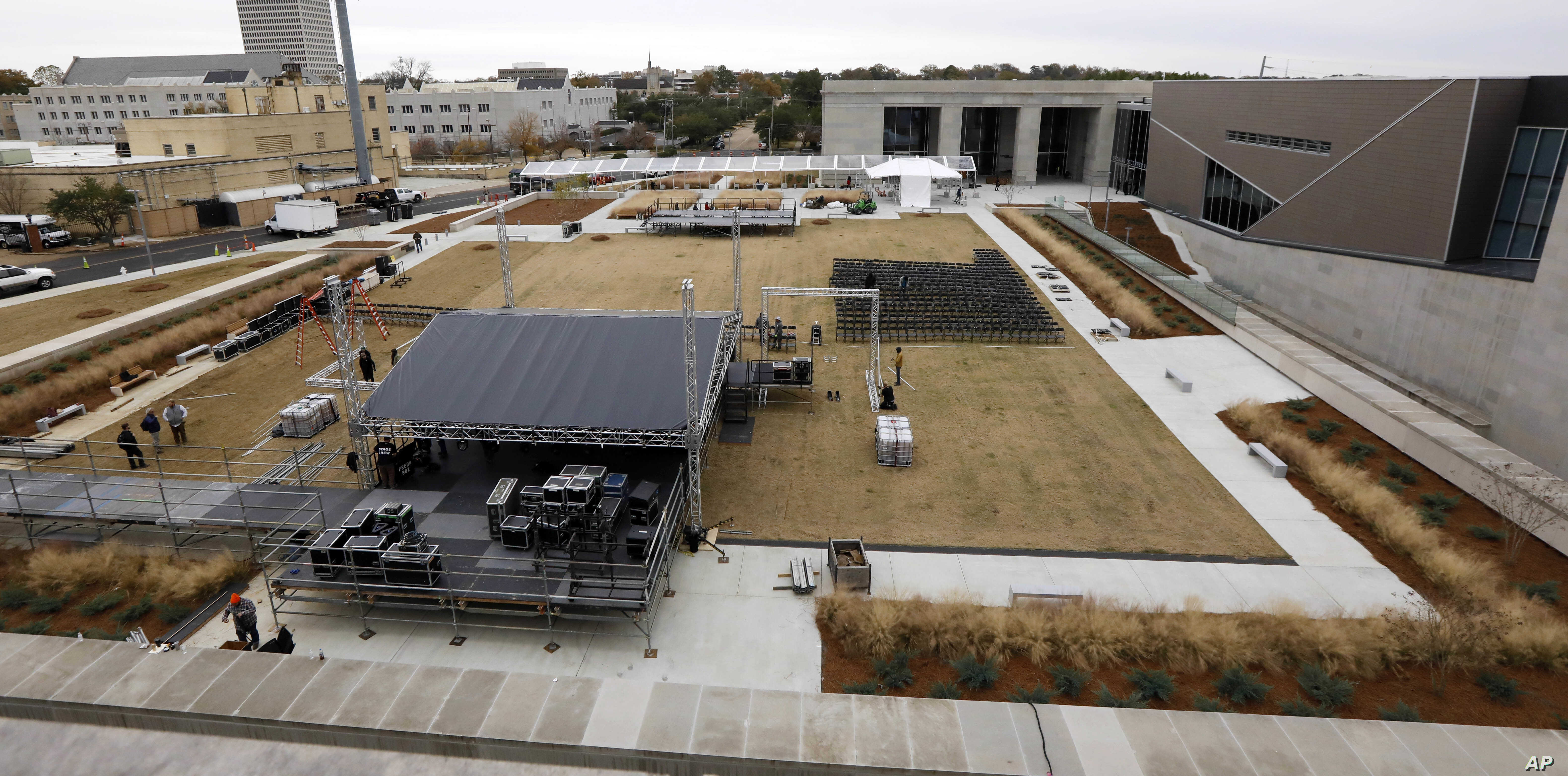 Work crews rush to set up a stage beside the state's two newest museums, the Museum of Mississippi History and the Mississippi Civil Rights Museum, Dec. 7, 2017, in Jackson, Miss. The long-planned Saturday ceremony will mark Mississippi's bicentennia...