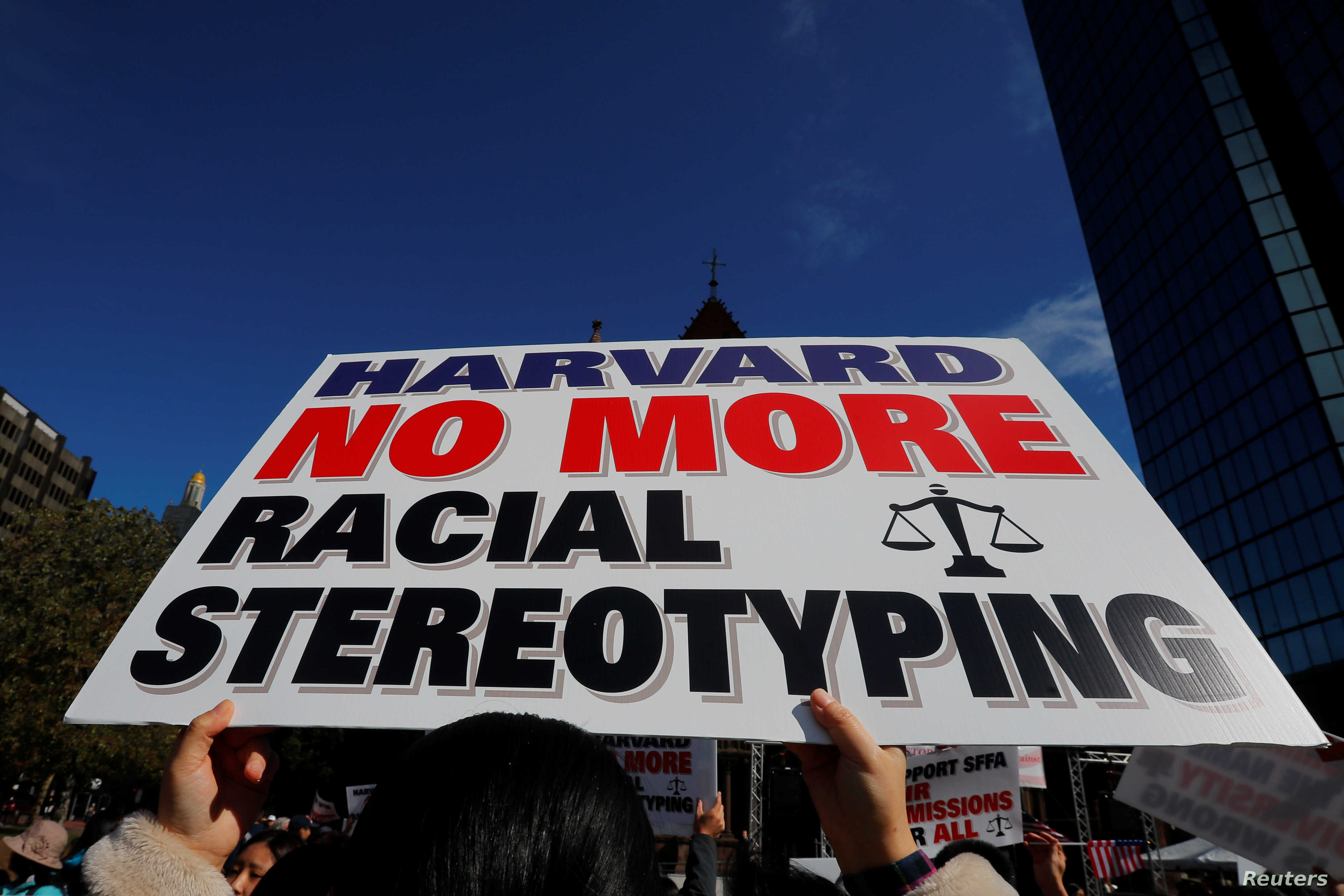 "A supporter carrying a ""Harvard No More Racial Stereotyping"" sign attends the ""Rally for the American Dream - Equal Education Rights for All,"" ahead of the start of the trial in a lawsuit accusing Harvard University of discriminating against Asian-Am"
