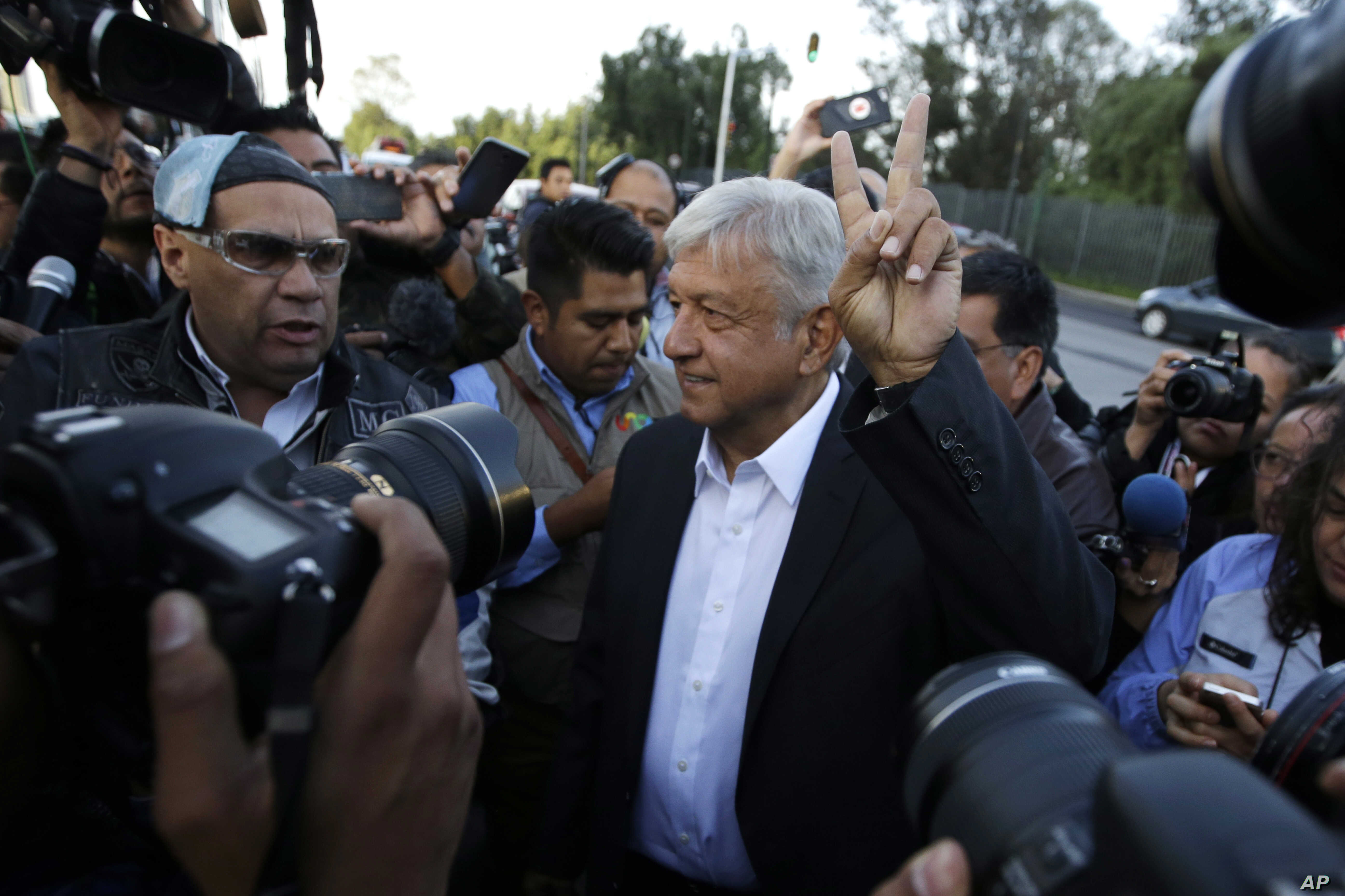 Presidential candidate Andres Manuel Lopez Obrador, of the MORENA party, arrives to a polling station during general elections in Mexico City, Mexico,  July 1, 2018.