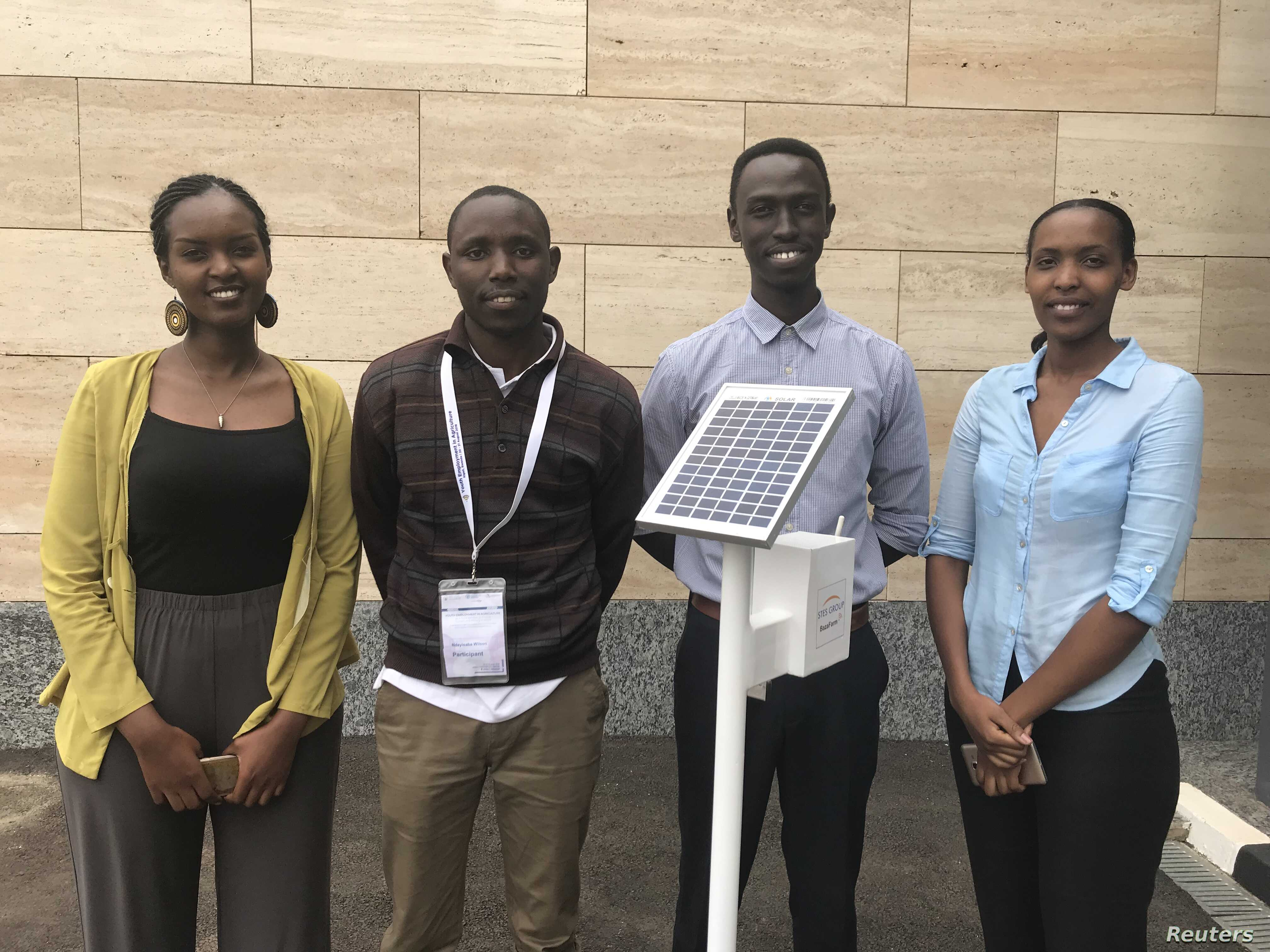Four of the team members of Rwanda's STES Group pose with their $400 solar-powered device with sensors and connectivity that can optimise water and fertiliser use, in Kigali, Aug 21, 2018.