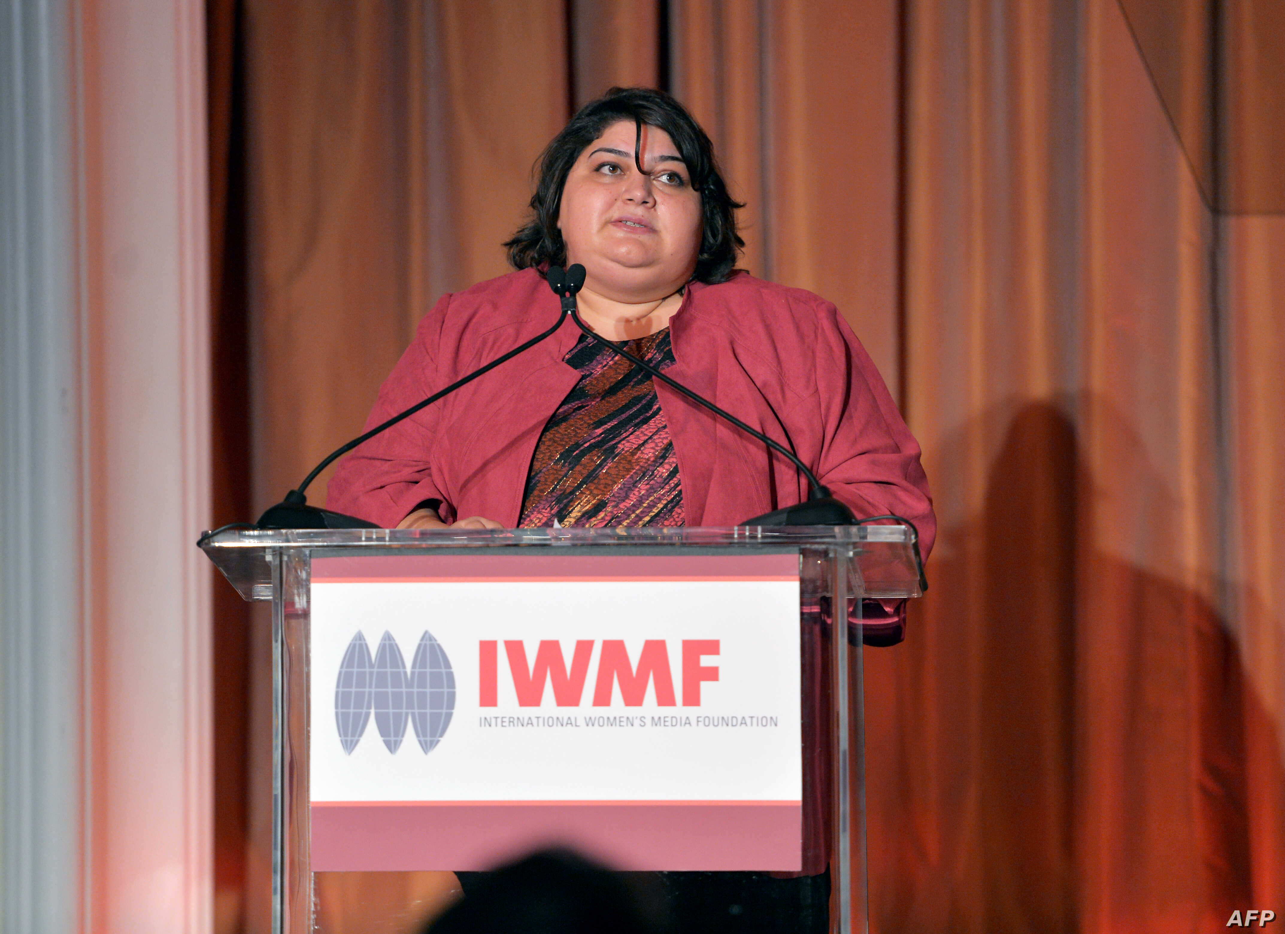 FILE - Honoree Khadija Ismayilova speaks onstage at the 2012 Courage in Journalism Awards hosted by the International Women's Media Foundation held at the Beverly Hills Hotel, Beverly Hills, California, Oct. 29, 2012.