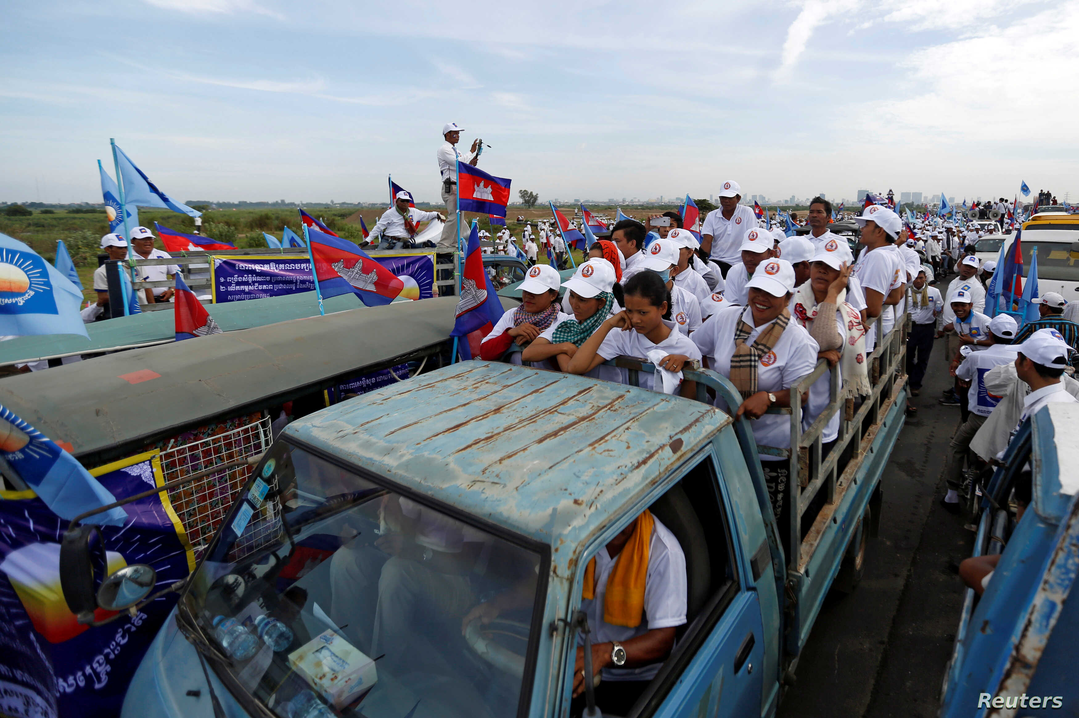 Supporters of the Cambodian People's Party (CPP) stand on a truck as they are surrounded by supporters of the Cambodia National Rescue Party (CNRP) during a local election campaign in Phnom Penh, Cambodia May 20, 2017.