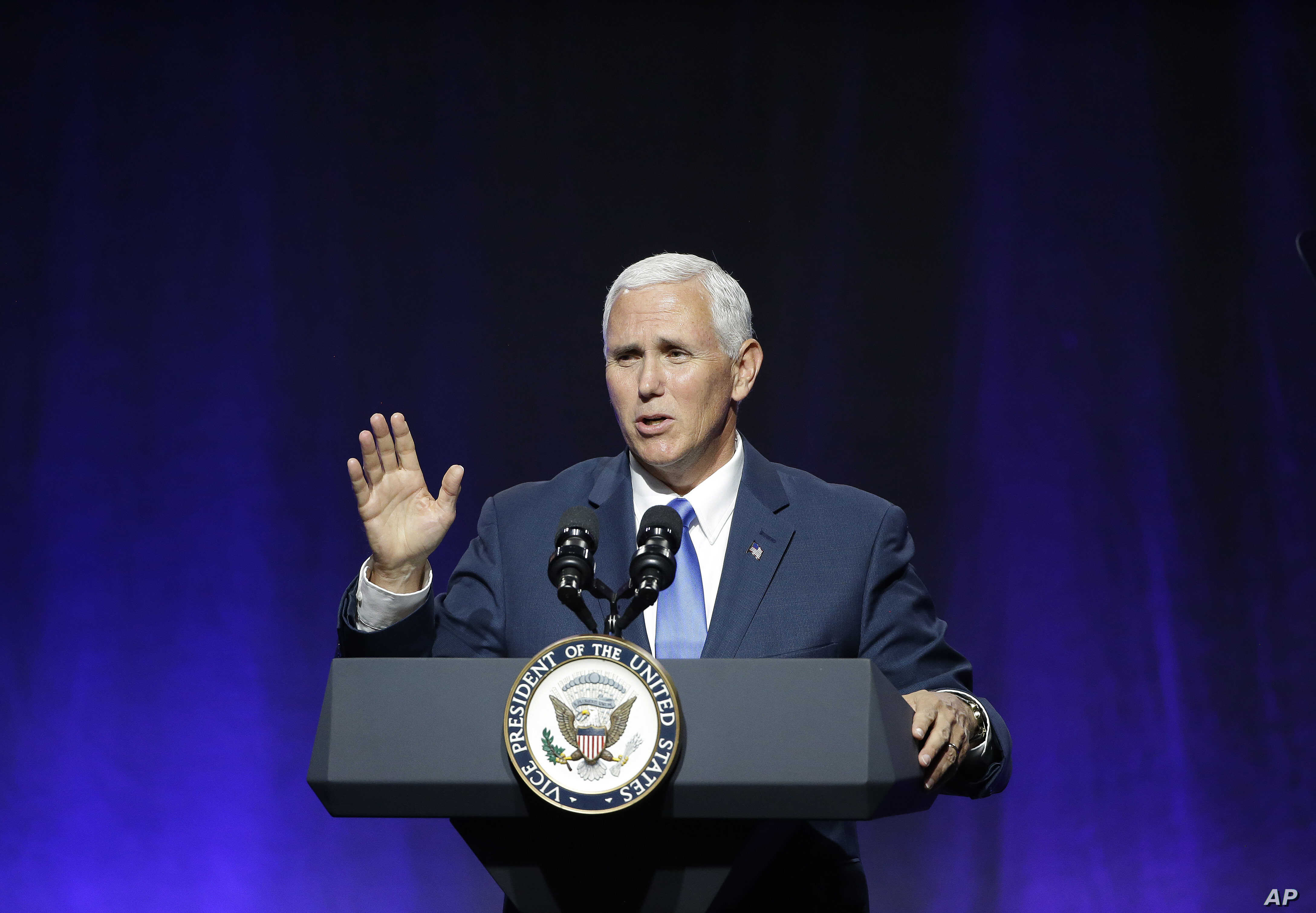 "Vice President Mike Pence waves goodbye as he wraps up an address to a NGA session titled ""Collaborating to Create Tomorrow's Global Economy,"" July 14, 2017, in Providence, R.I."