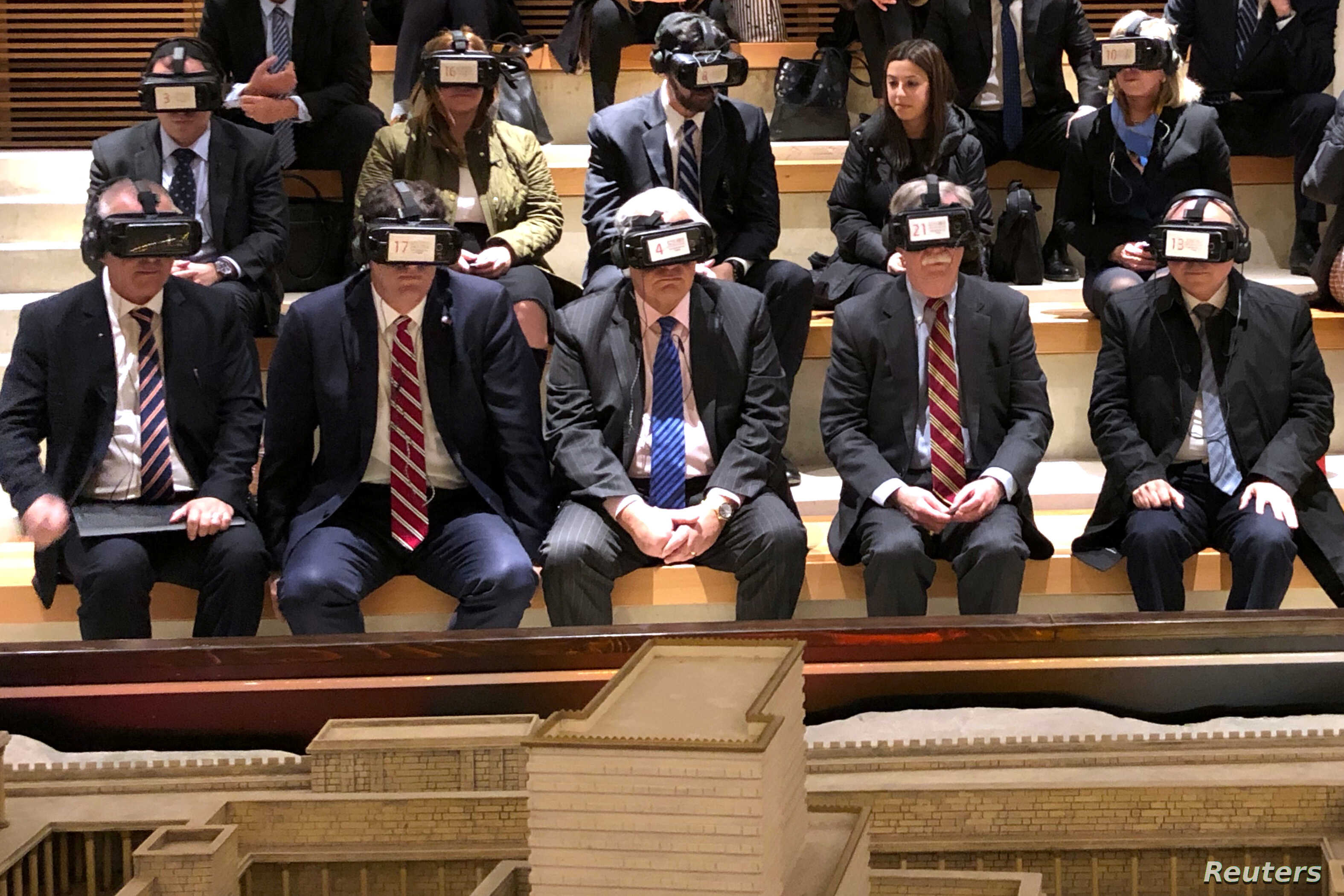 White House national security adviser John Bolton (2nd R) wears virtual reality goggles during a visit to the Western Wall tunnel complex in Jerusalem's Old City, Jan. 6, 2019.