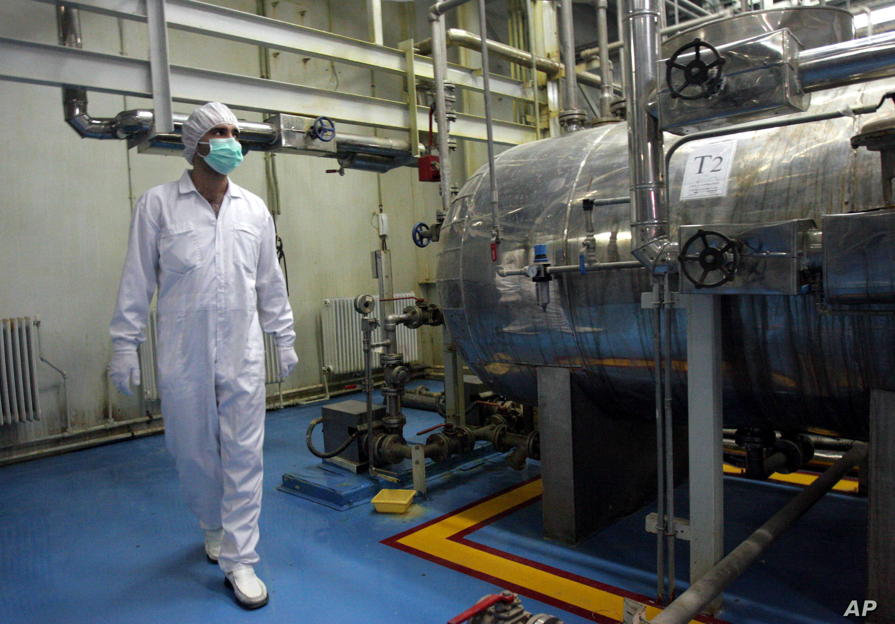 FILE - An Iranian technician walks through the Uranium Conversion Facility just outside the city of Isfahan, south of the capital Tehran.