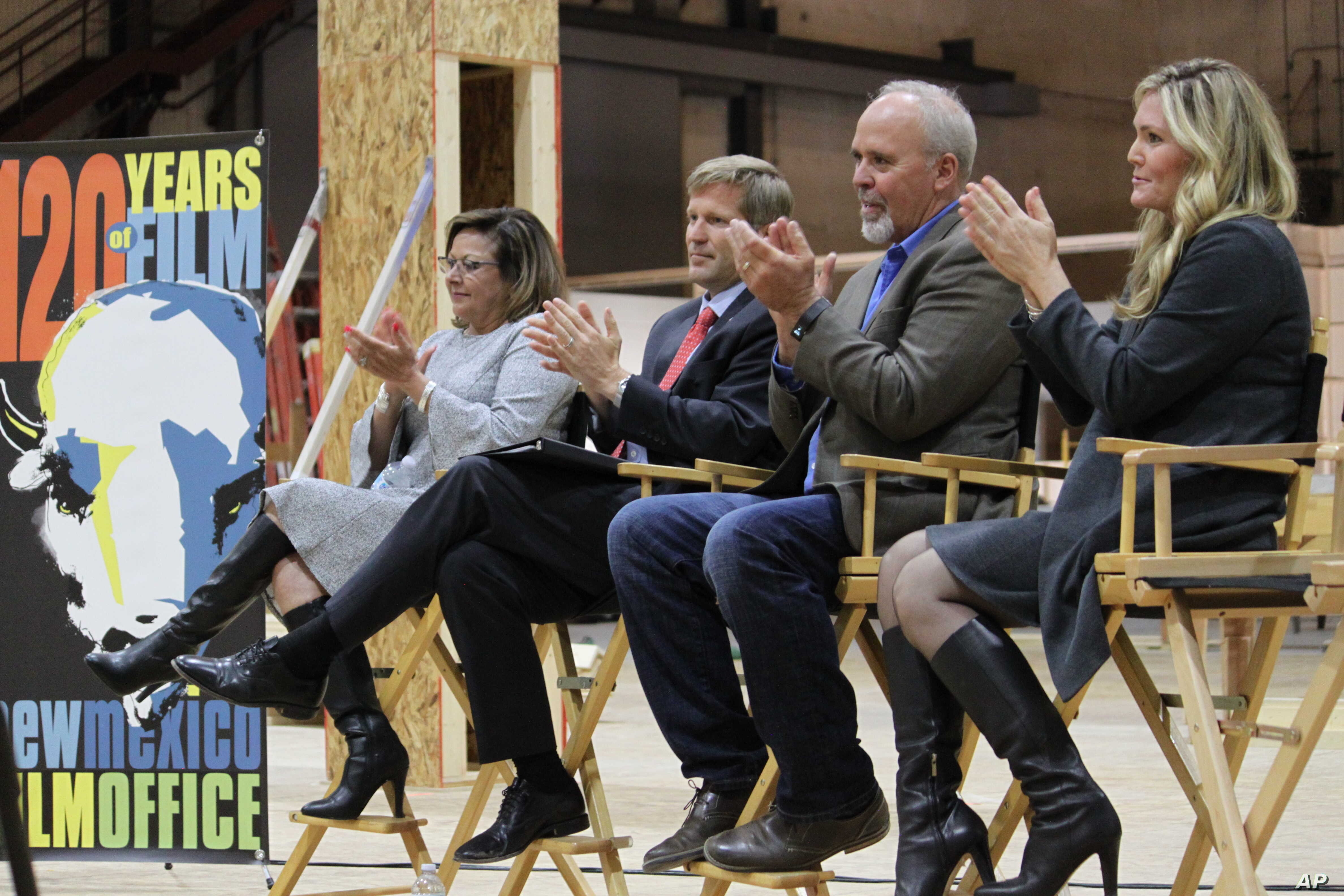 New Mexico Gov. Susana Martinez, from left, Albuquerque Mayor Tim Keller, Netflix vice president for physical production Ty Warren and Albuquerque film liaison Alicia Keyes headline a news conference at ABQ Studios in Albuquerque, N.M., Oct. 8, 2018....
