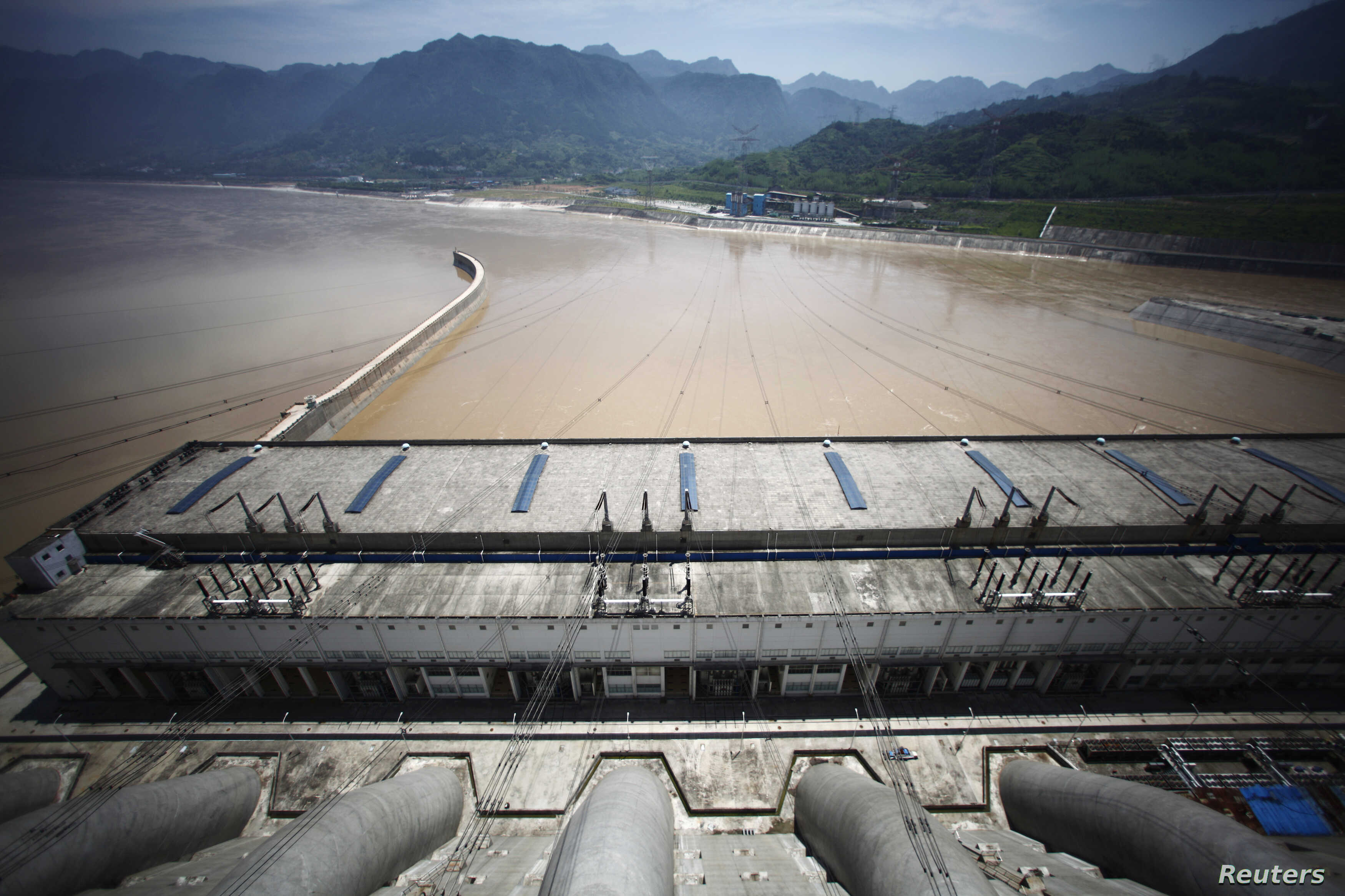 FILE - A view from the Three Gorges dam over the Yangtze River in Yichang, Hubei province August 9, 2012. The environmental problems associated with the Three Gorges dam illustrate China's energy dilemma: To move away from its reliance on coal-fired ...