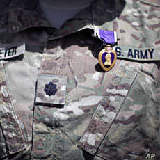 A Purple Heart medal is seen on the uniform of U.S Army Lt Colonel Alan Streeter after U.S. Secretary of Defense Robert Gates presented the award for wounds he received in combat, during a ceremony at Combat Outpost Andar in Ghazni Province, Afghanis...