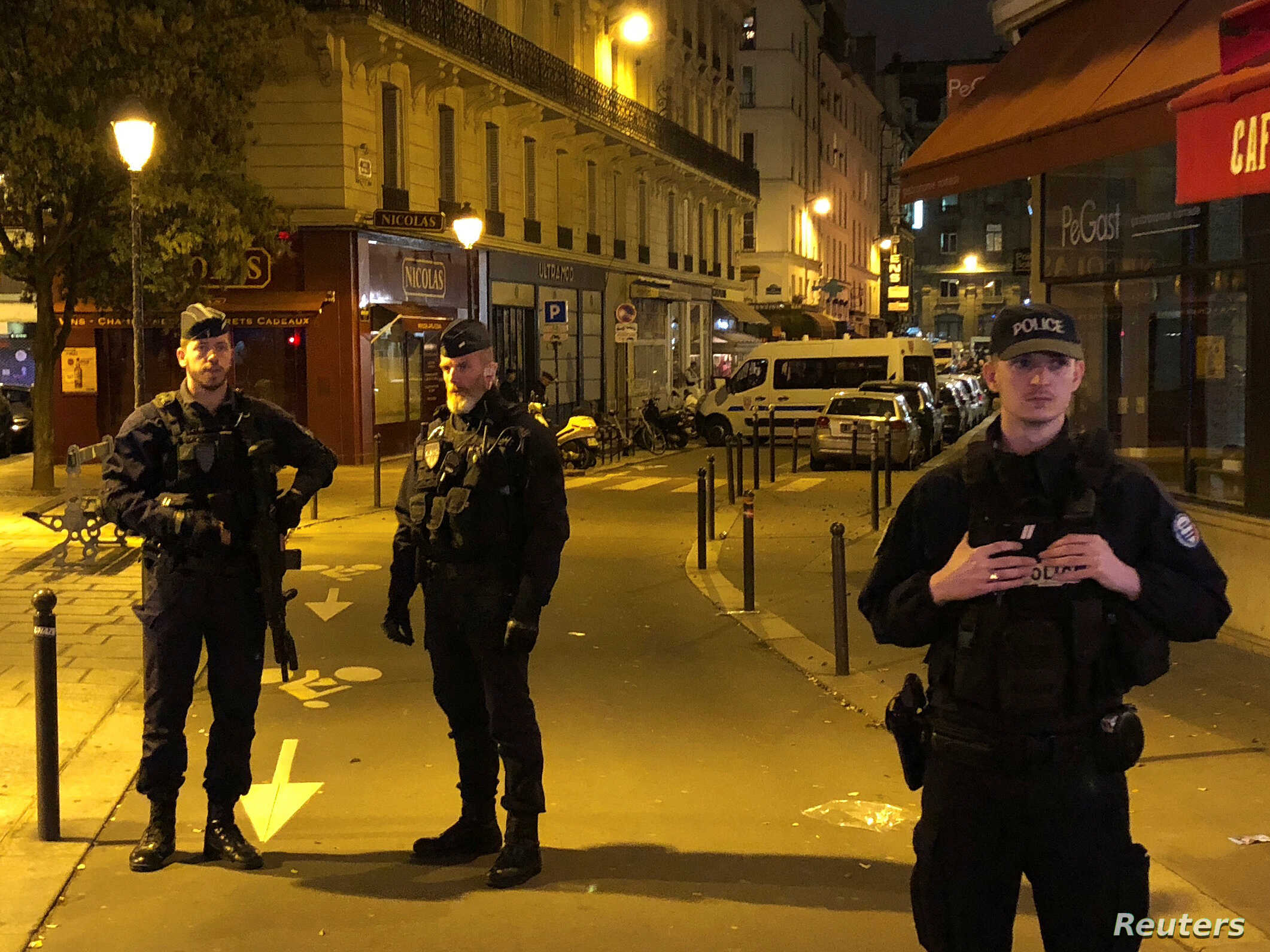French police secure a street after a man killed a passer-by in a knife attack in Paris and injured four others before being shot dead by police, May 12, 2018.