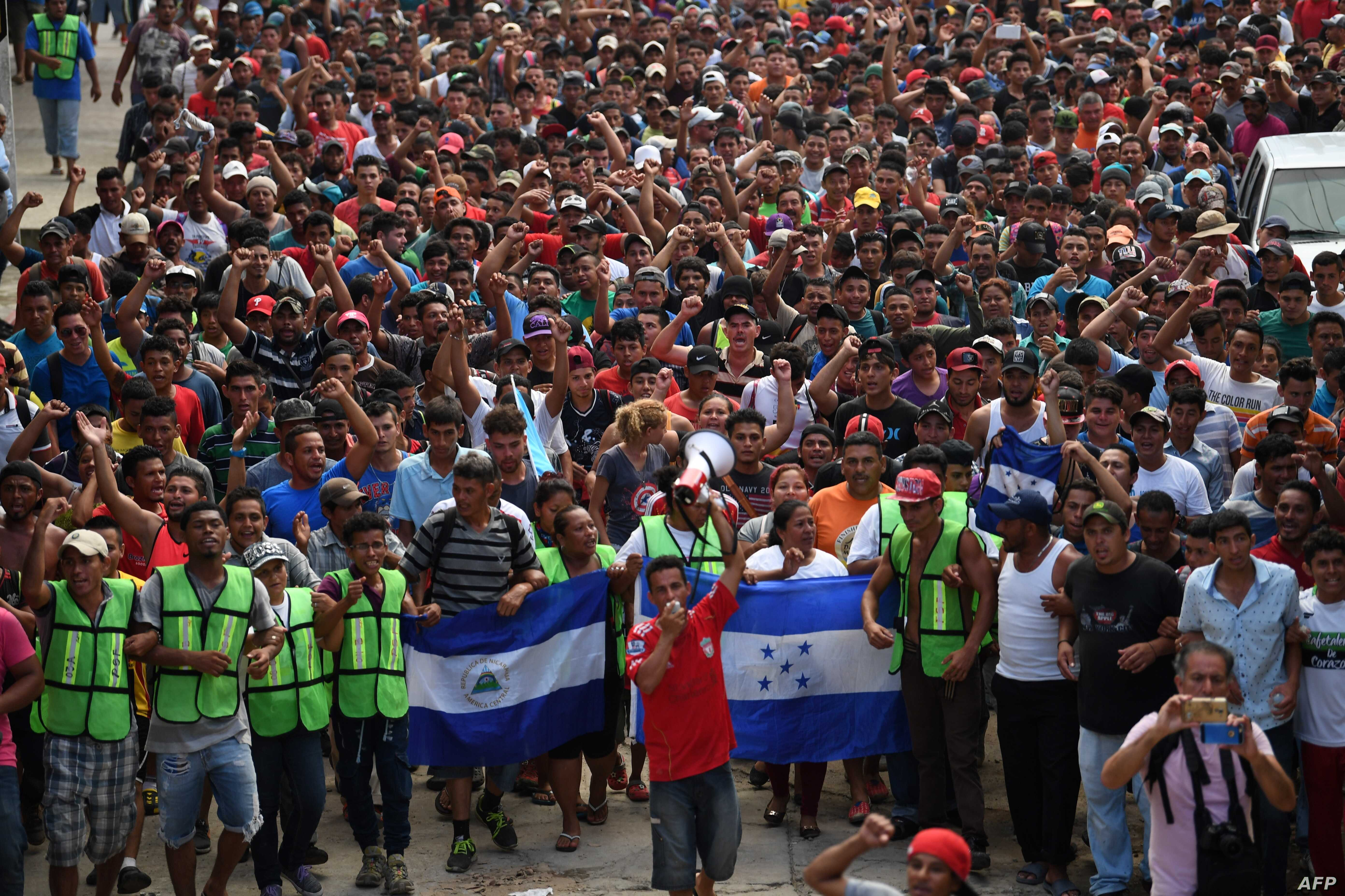 Honduran migrants heading in a caravan to the US, hold a demonstration demanding authorities to allow the rest of the group to cross, in Ciudad Hidalgo, Chiapas state, Mexico after crossing from Guatemala, Oct. 20, 2018.