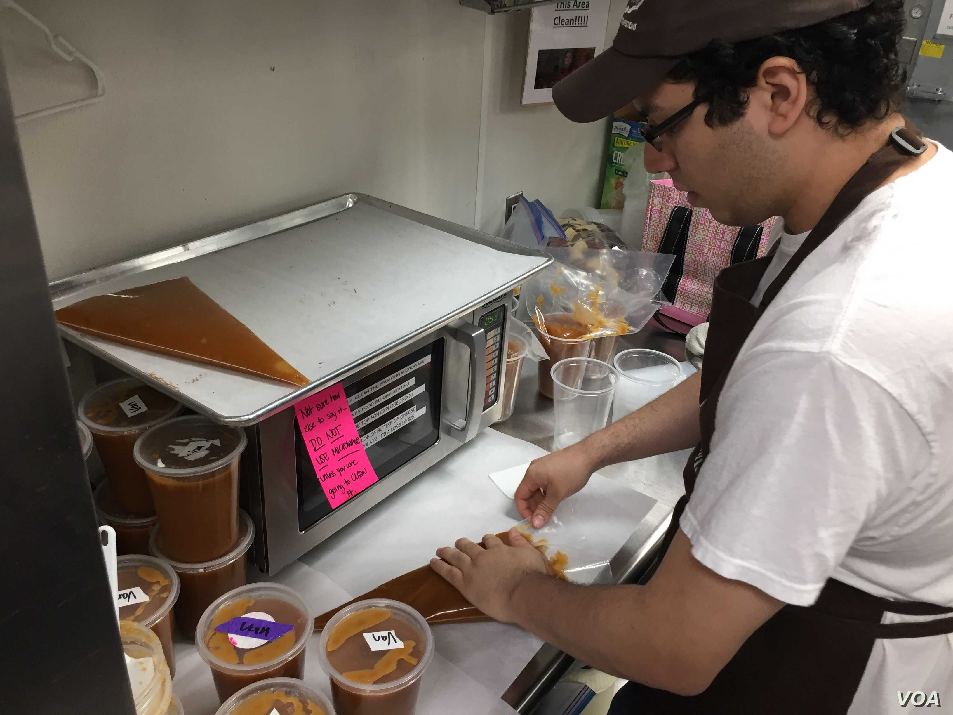 Jonathan Turcios says what he likes best about his job is being part of the chocolate-making team. (VOA Photo/J.Taboh)