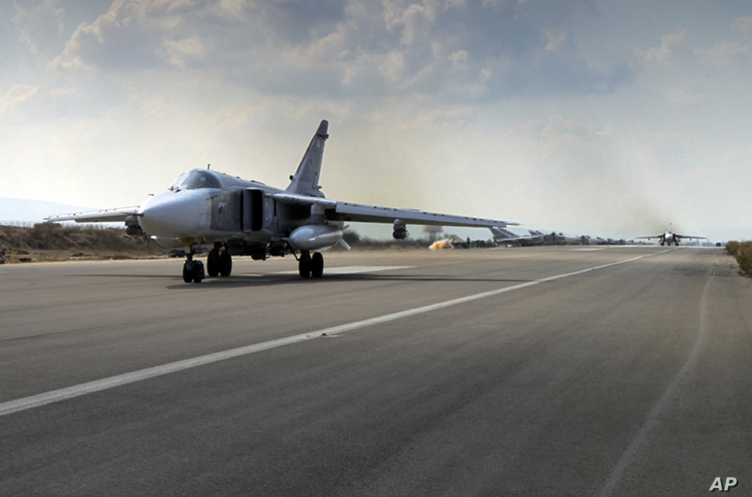 In this photo taken from Russian Defense Ministry official website on Oct. 6, 2015, a Russian  SU-24M jet fighter prepares to take off from an airbase Hmeimim in Syria.
