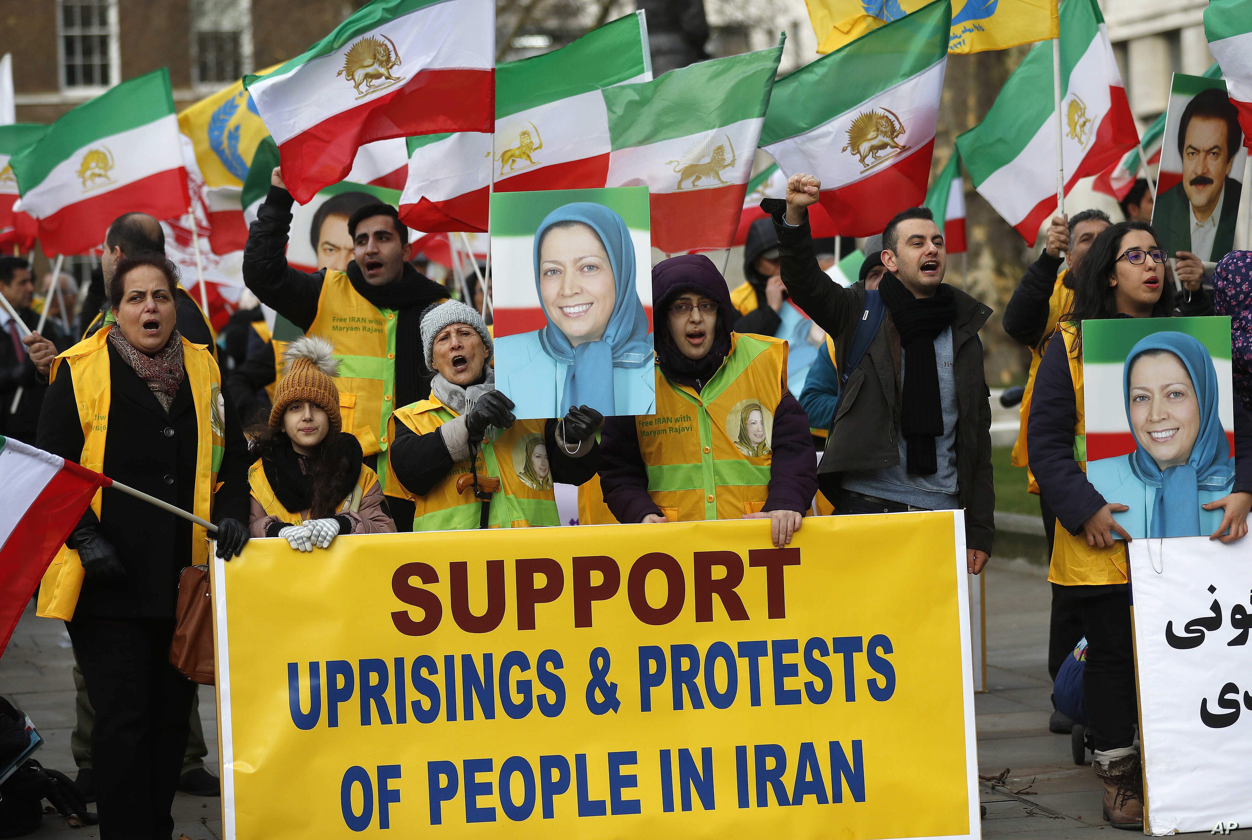 The Anglo-Iranian communities, supporters of Iran's democratic opposition, the National Council of Resistance of Iran (NCRI) and main organised opposition movement PMOI, hold a rally opposite the entrance of 10 Downing Street in London, Jan. 4, 2018.