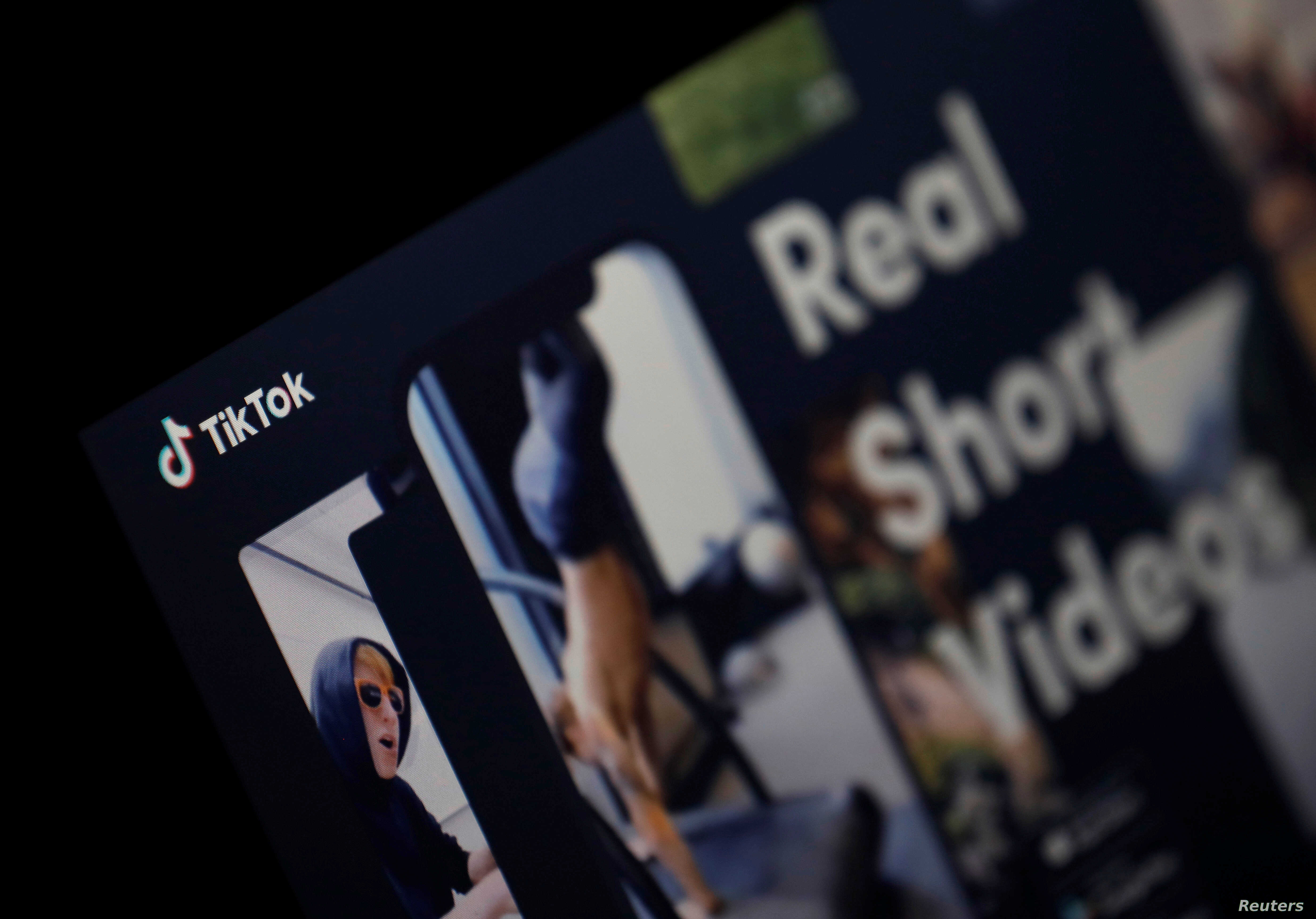 The logo of the TikTok application is seen on a screen.