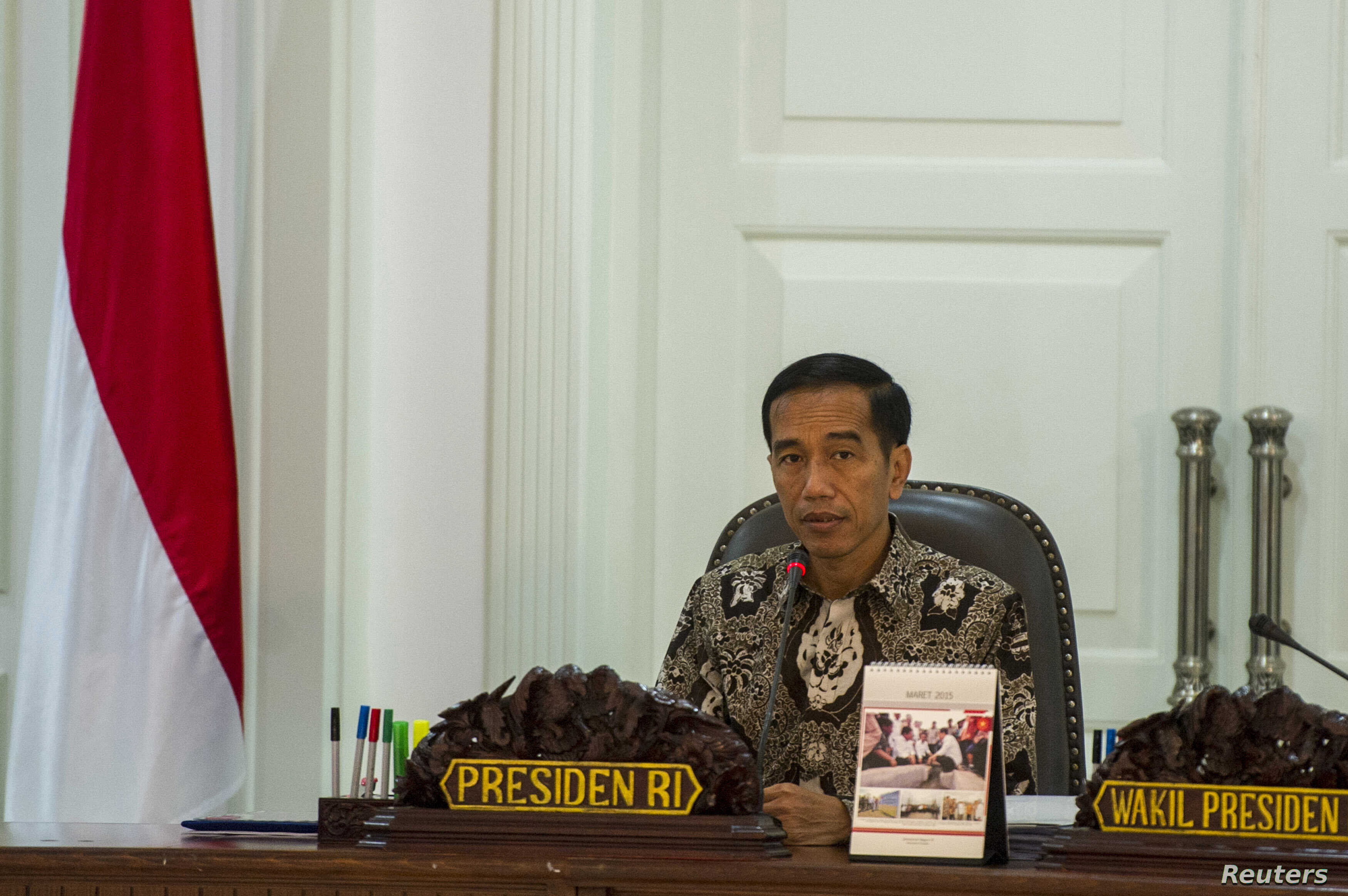 FILE - Indonesia's President Joko Widodo leads a cabinet meeting at the Presidential Palace in Jakarta, March 4, 2015.