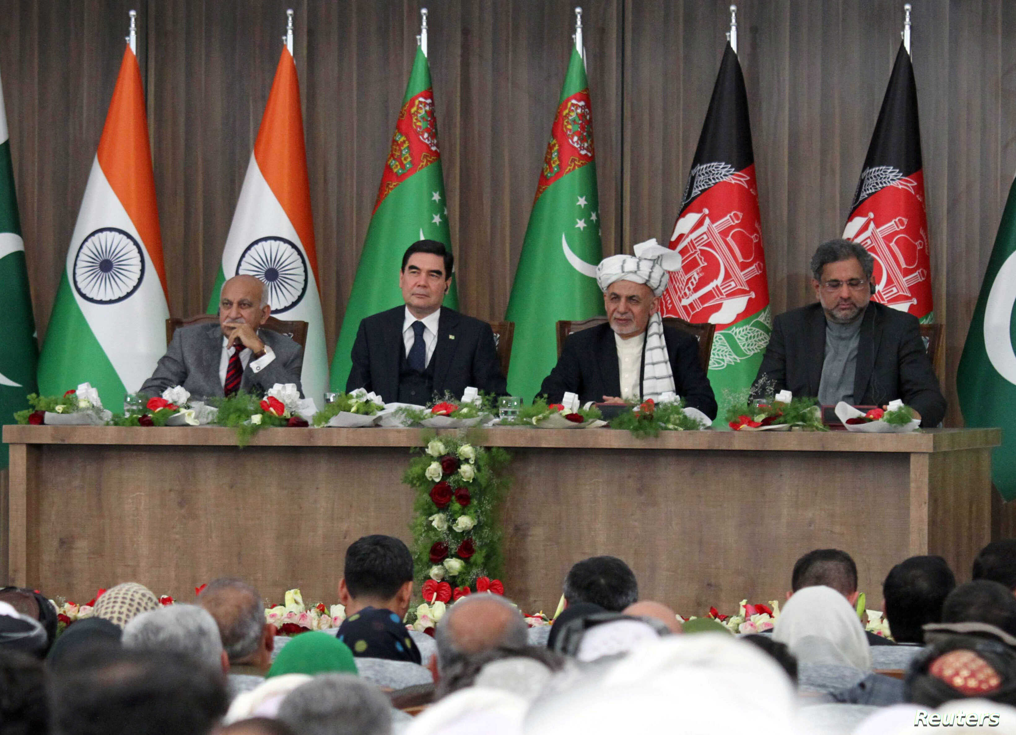 Afghanistan President Ashraf Ghani, 2nd right, Pakistani Prime Minister Shahid Khaqan Abbasi, right, Turkmenistan President Gurbanguly Berdymukhamedov, 2nd left, and India's Minister of State for External Affairs M.J. Akbar, left, attend the inaugura...