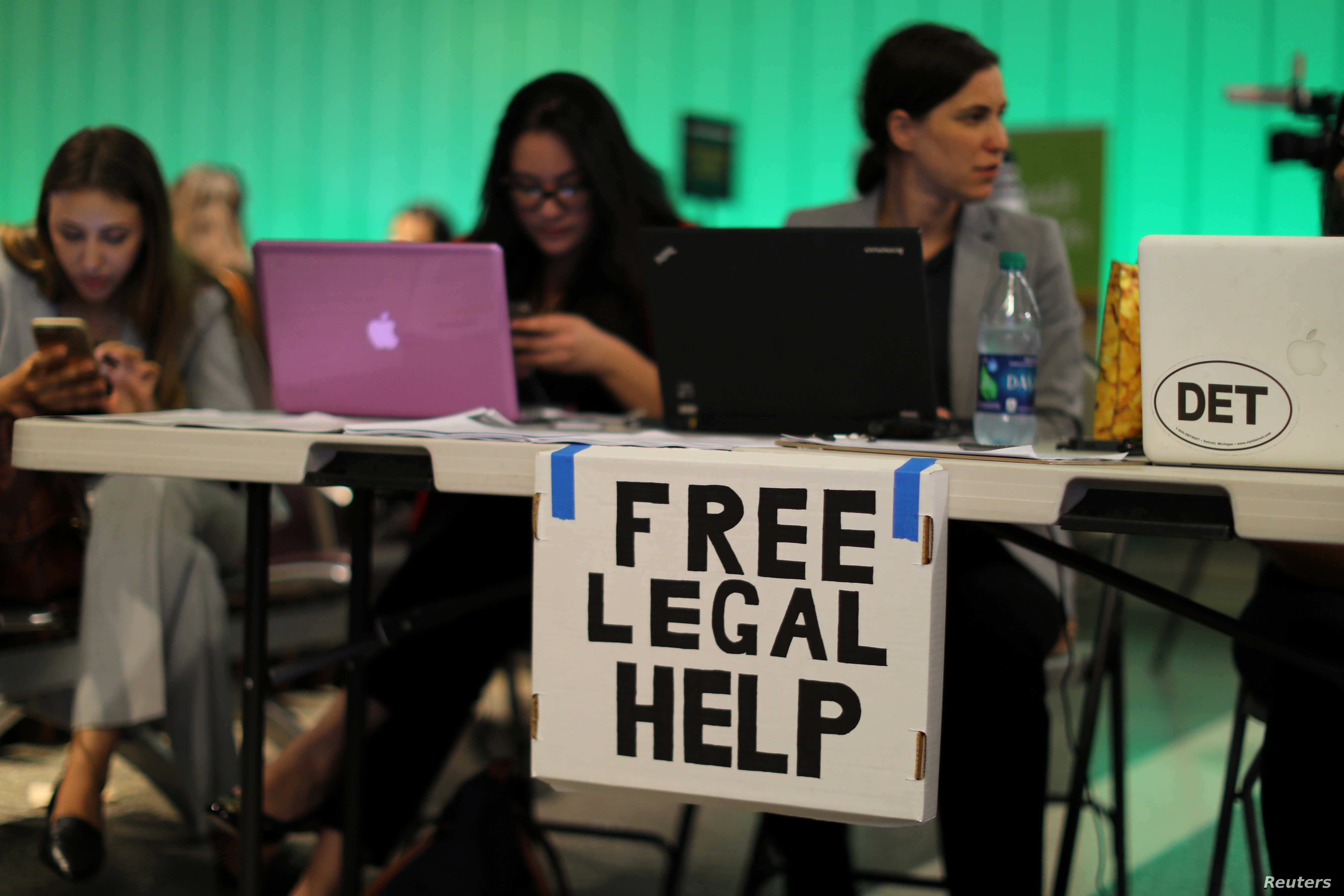 Volunteer lawyers set up a table to help arriving passengers following the reinstatement by the U.S. Supreme Court of portions of President Donald Trump's executive order targeting travelers from six predominantly Muslim countries, at Los Angeles Int...