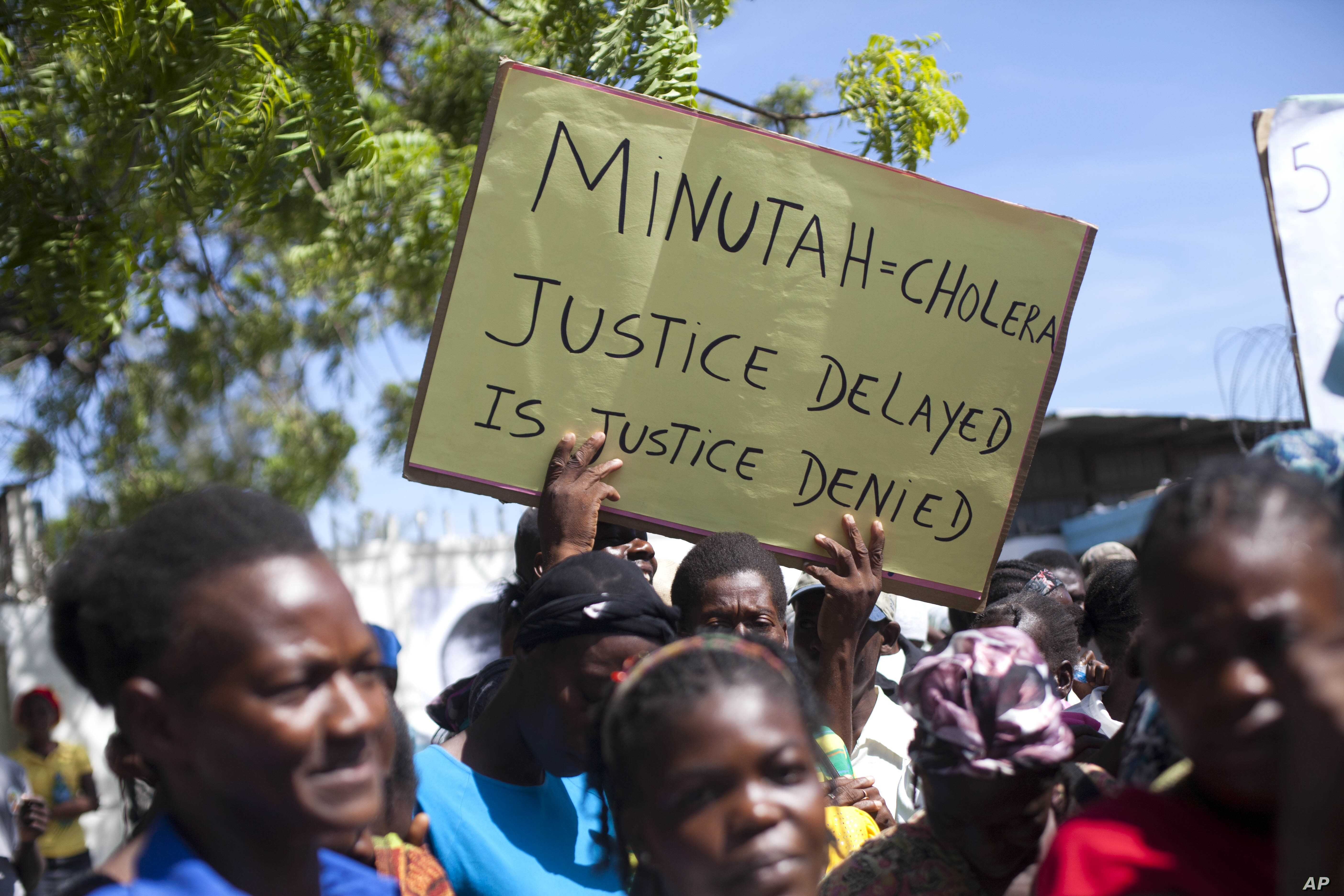 FILE - Cholera survivors protest the United Nations peacekeeping mission outside U.N. headquarters in Port-au-Prince, Haiti.