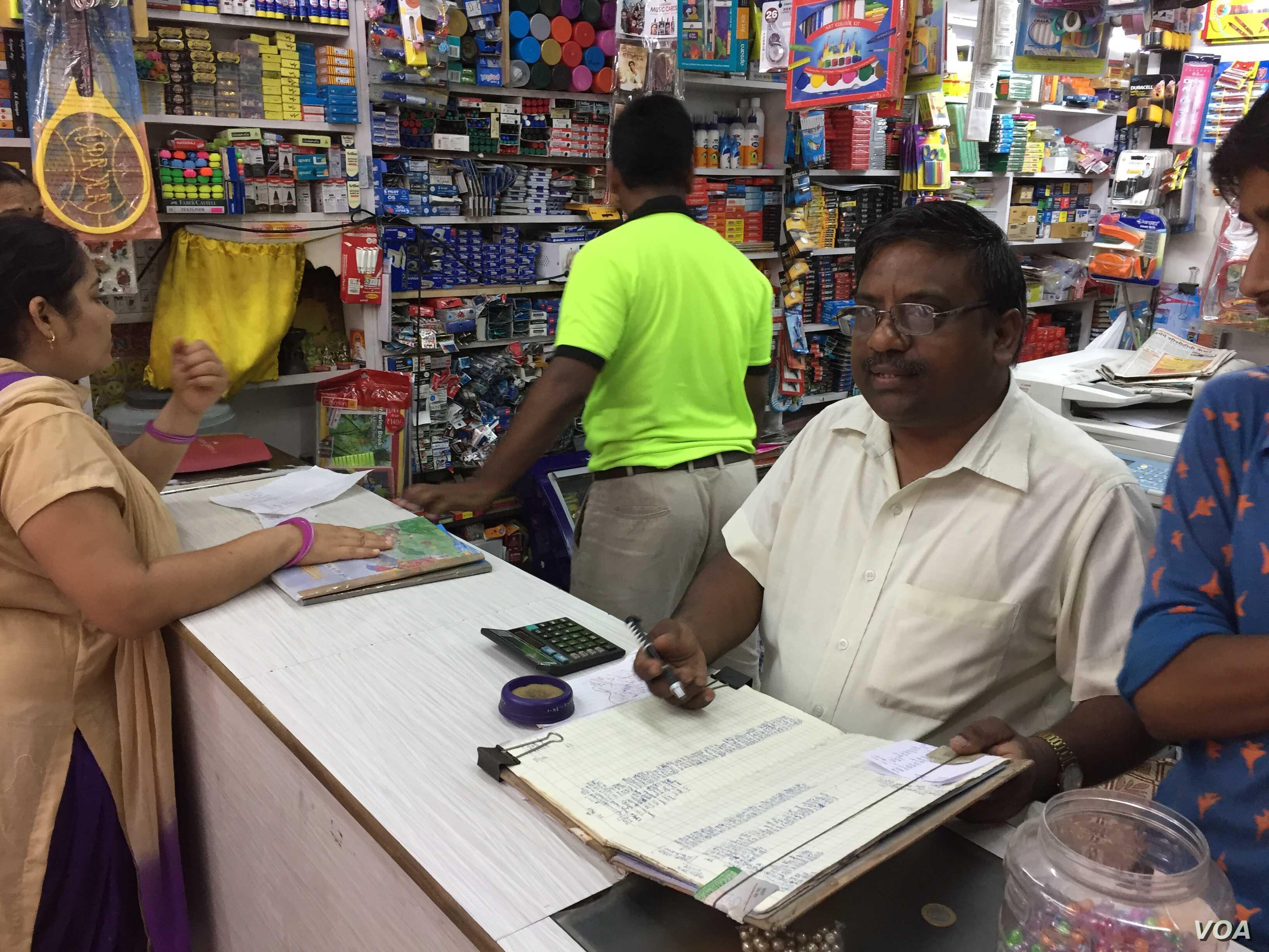 Store owner Vimal Jain in New Delhi, who like millions of shopkeepers, maintained records in ledgers and issued paper receipts, says the transition to GST will disrupt his business, just as the currency ban did last November.