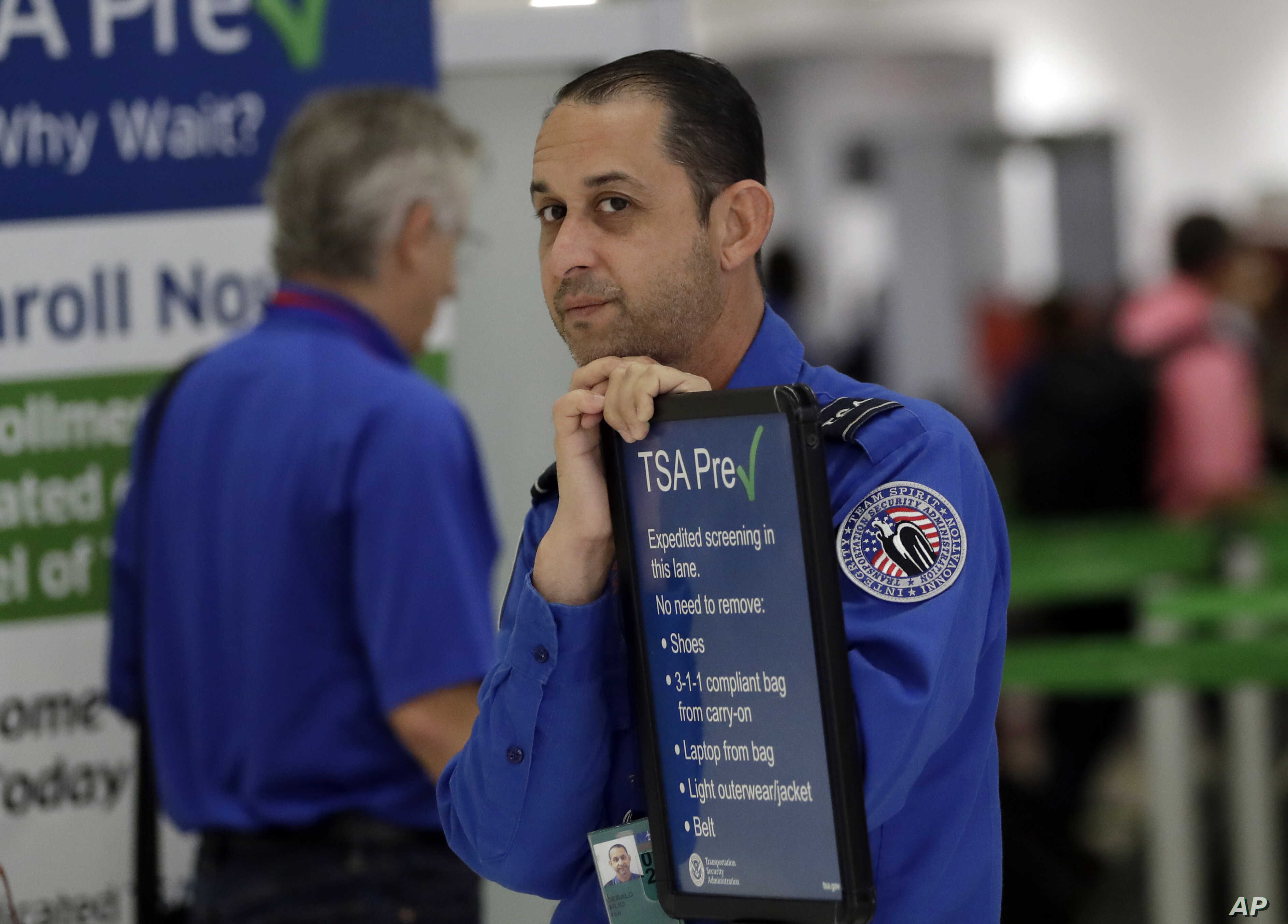 A Transportation Security Administration employee works at a security checkpoint at Miami International Airport, Jan. 18, 2019, in Miami.