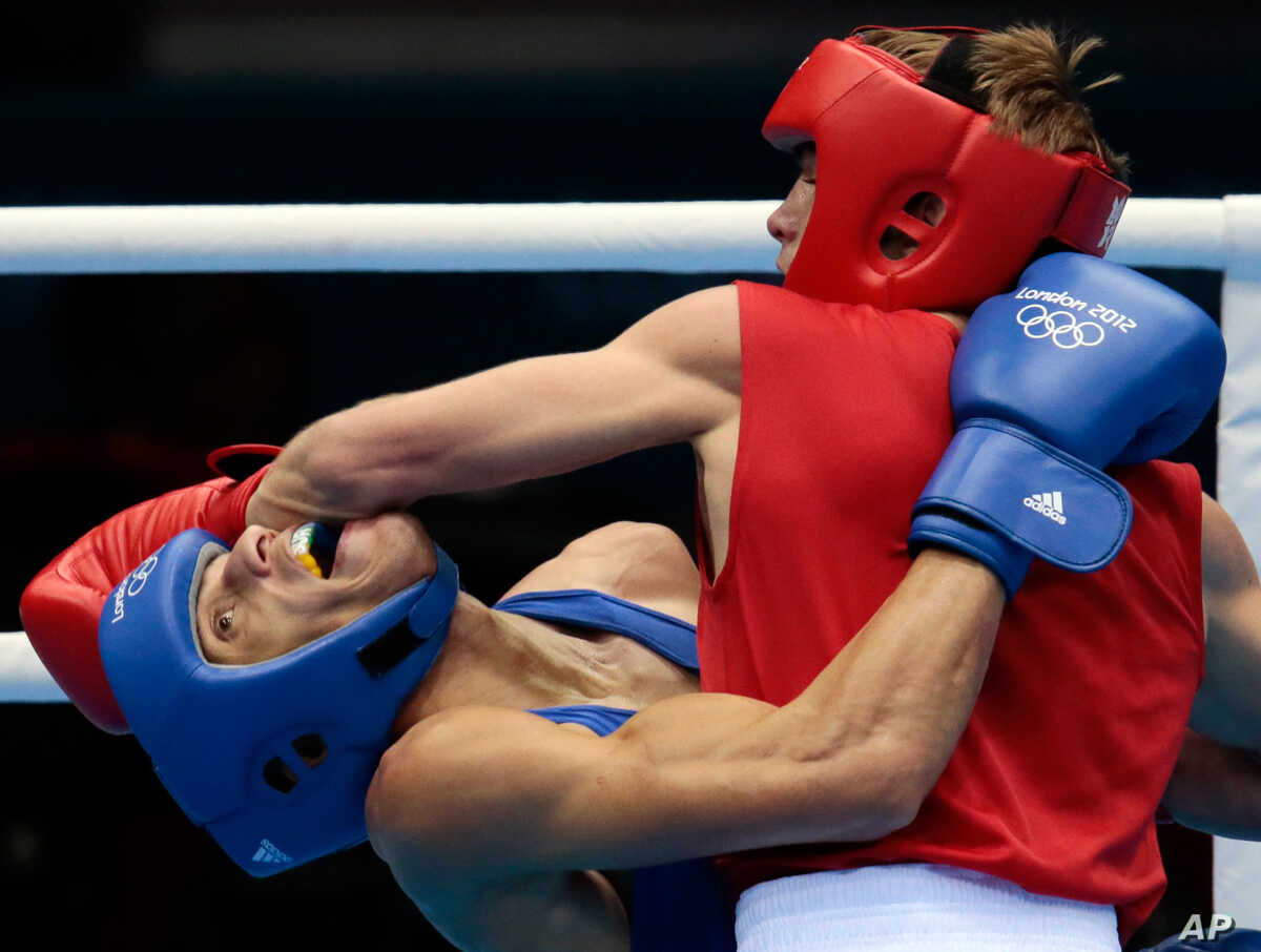 Russia's Sergey Vodopiyanov, right, fights Brazil's Robenilson Vieira de Jesus, during their men's bantam 56-kg boxing match.