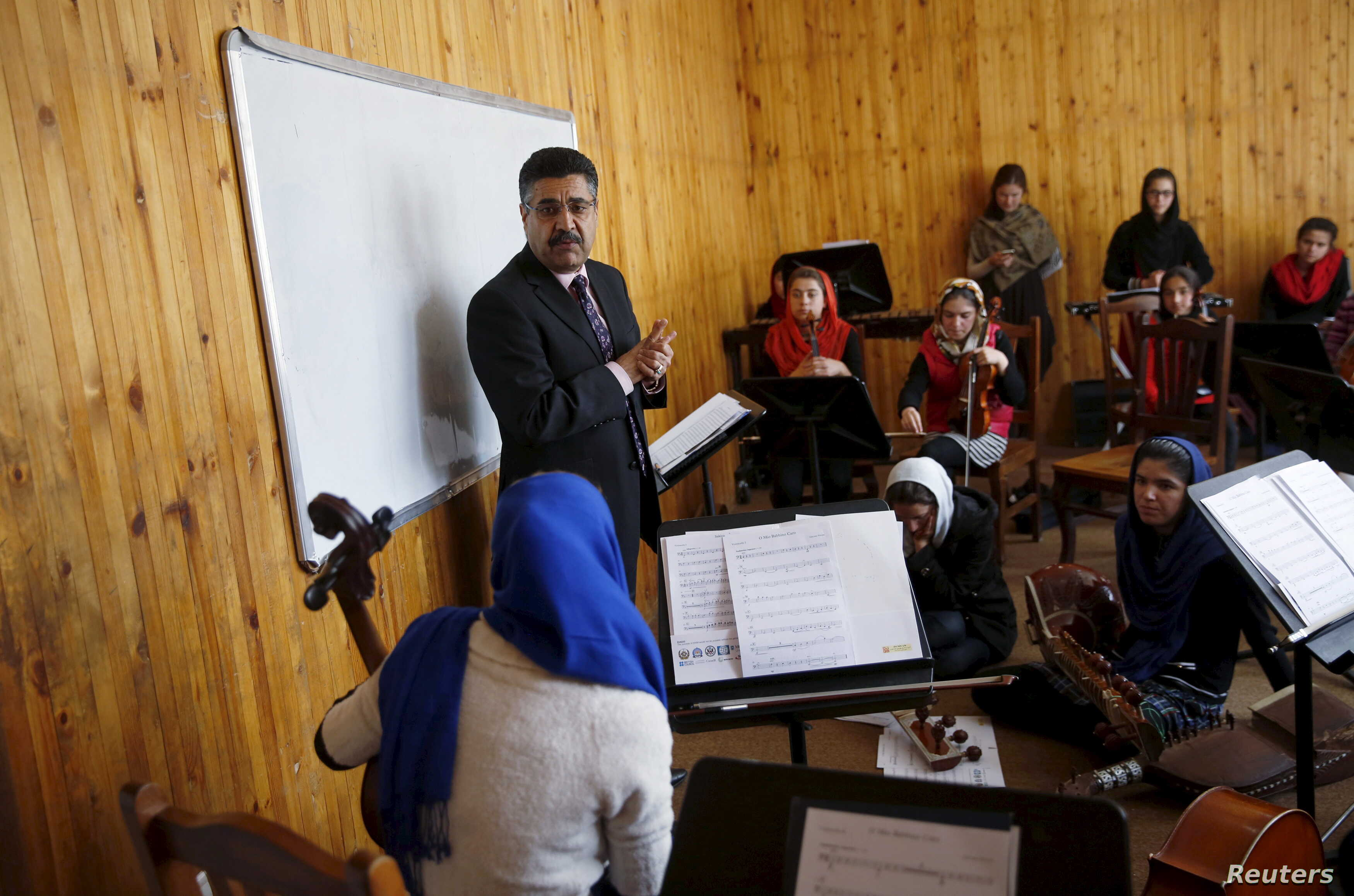 FILE - Ahmad Naser Sarmast, head of Afghanistan's National Institute of Music, speaks to members of the Zohra orchestra, an ensemble of 35 women, in Kabul, Afghanistan, April 4, 2016. Playing instruments was banned under Taliban rule in Afghanistan, ...