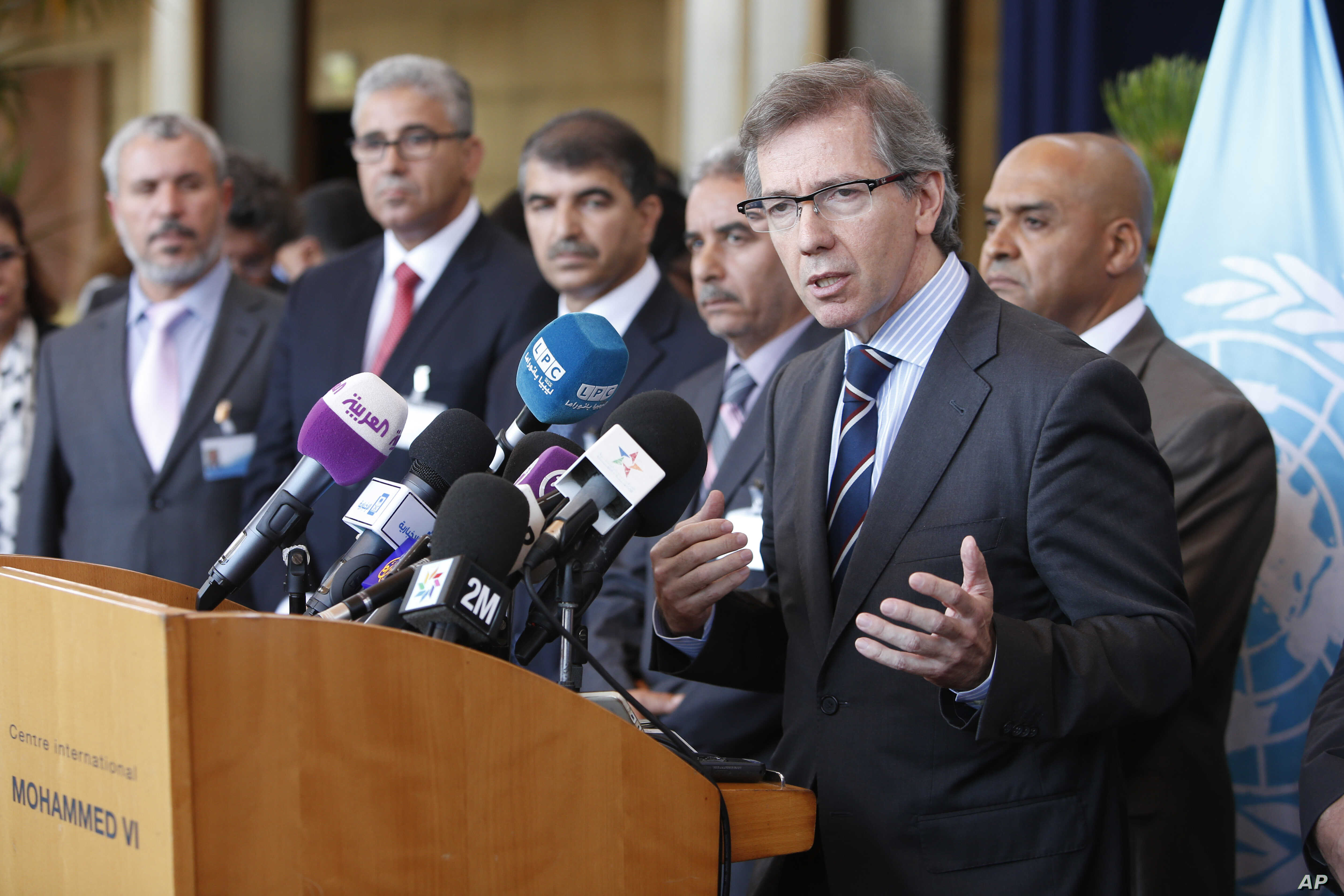 U.N. representative for Libya, Bernardino Leon, right,  addresses reporters while Libyan parliaments members listen in Rabat, Morocco, Sept. 18, 2015.