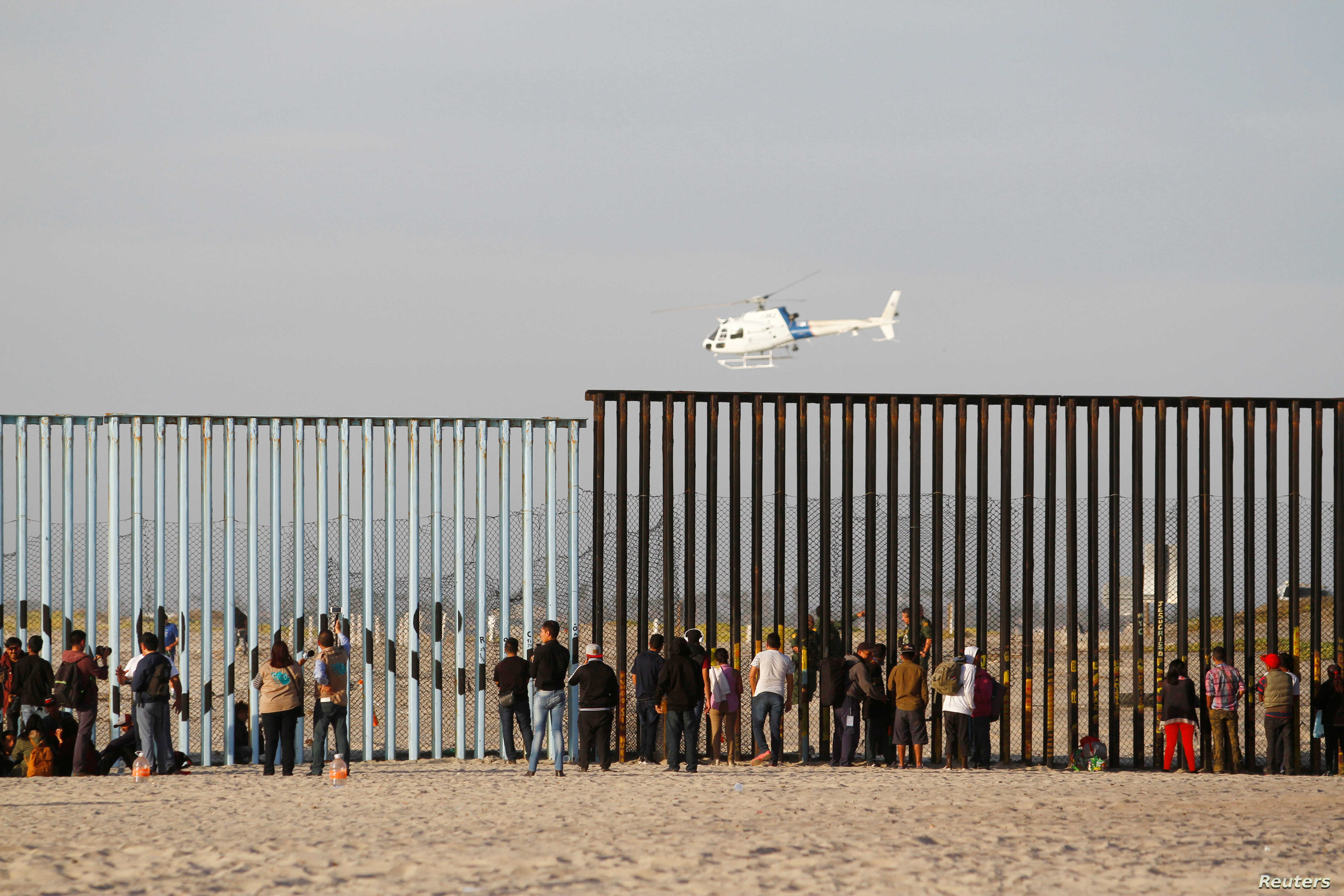 Migrants Reach US-Mexico Border, Likely Face Long Wait