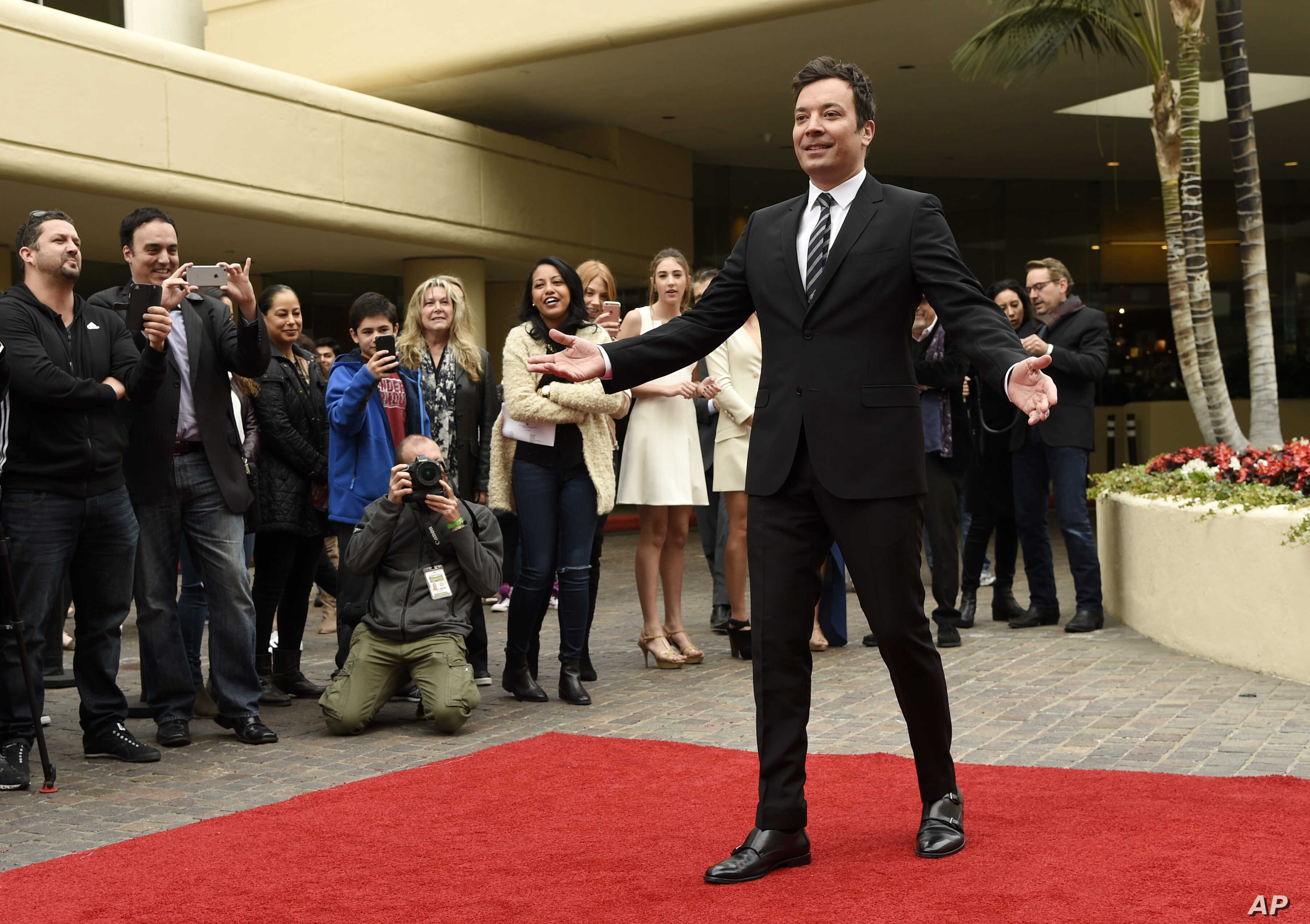 Jimmy Fallon, host of this Sunday's 74th Annual Golden Globe Awards, poses after rolling out the red carpet during Golden Globe Awards Preview Day at the Beverly Hilton on Wednesday, Jan. 4, 2017, in Beverly Hills, Calif.