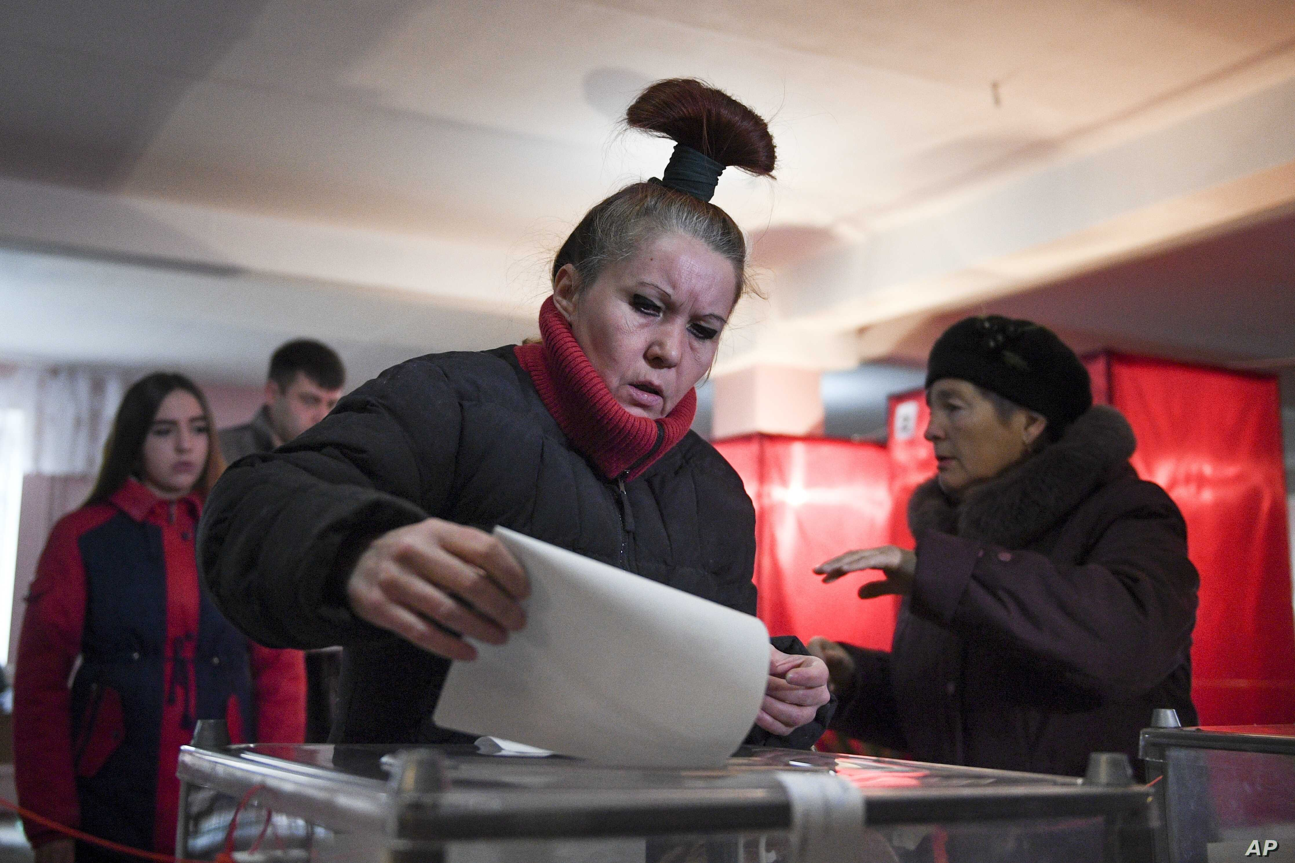 A woman casts her ballot at a polling station during rebel elections in Donetsk, Ukraine, Nov. 11, 2018.