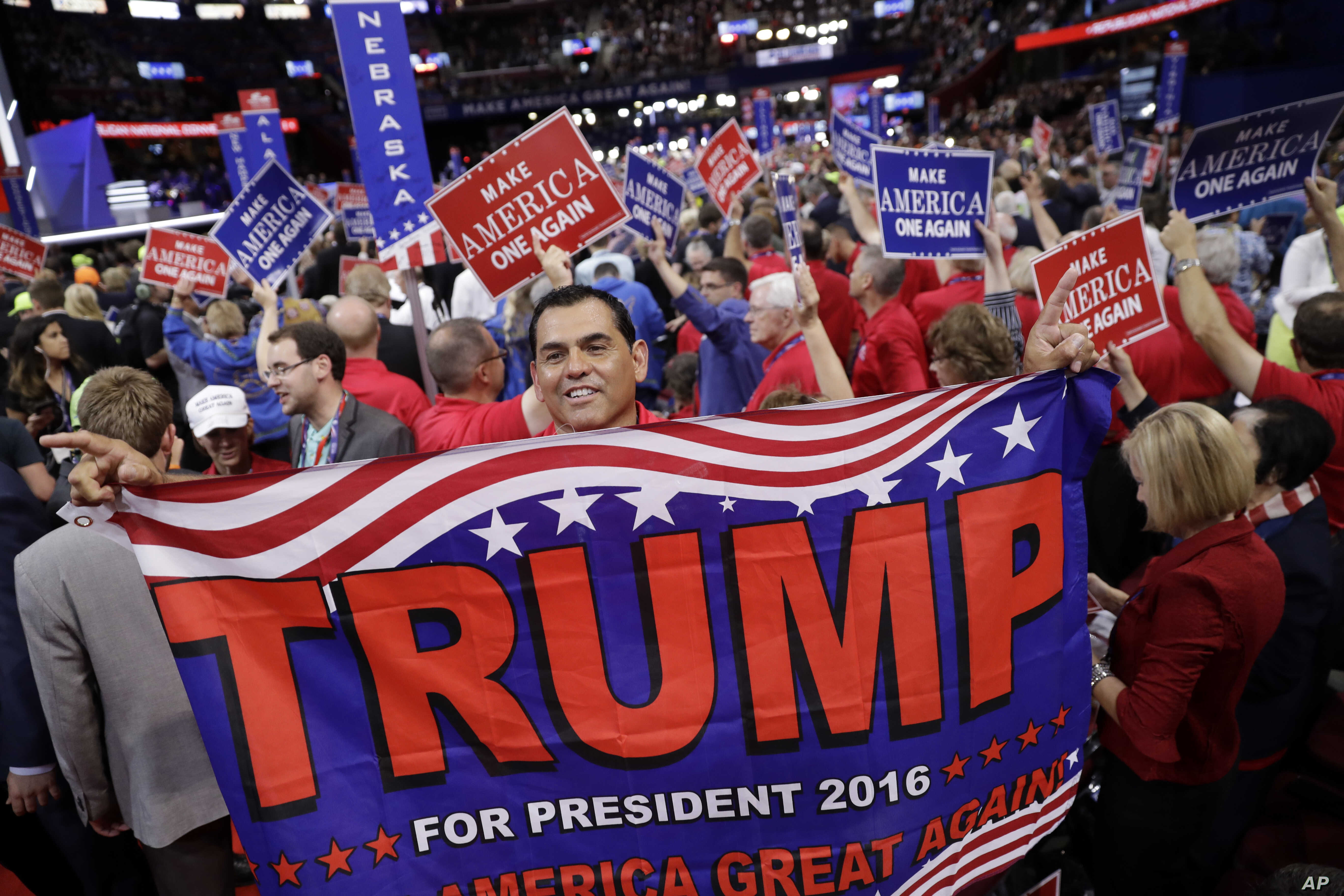 Alaska delegate Saul Soltero waves a Trump flag during the final day of the Republican National Convention in Cleveland, July 21, 2016.