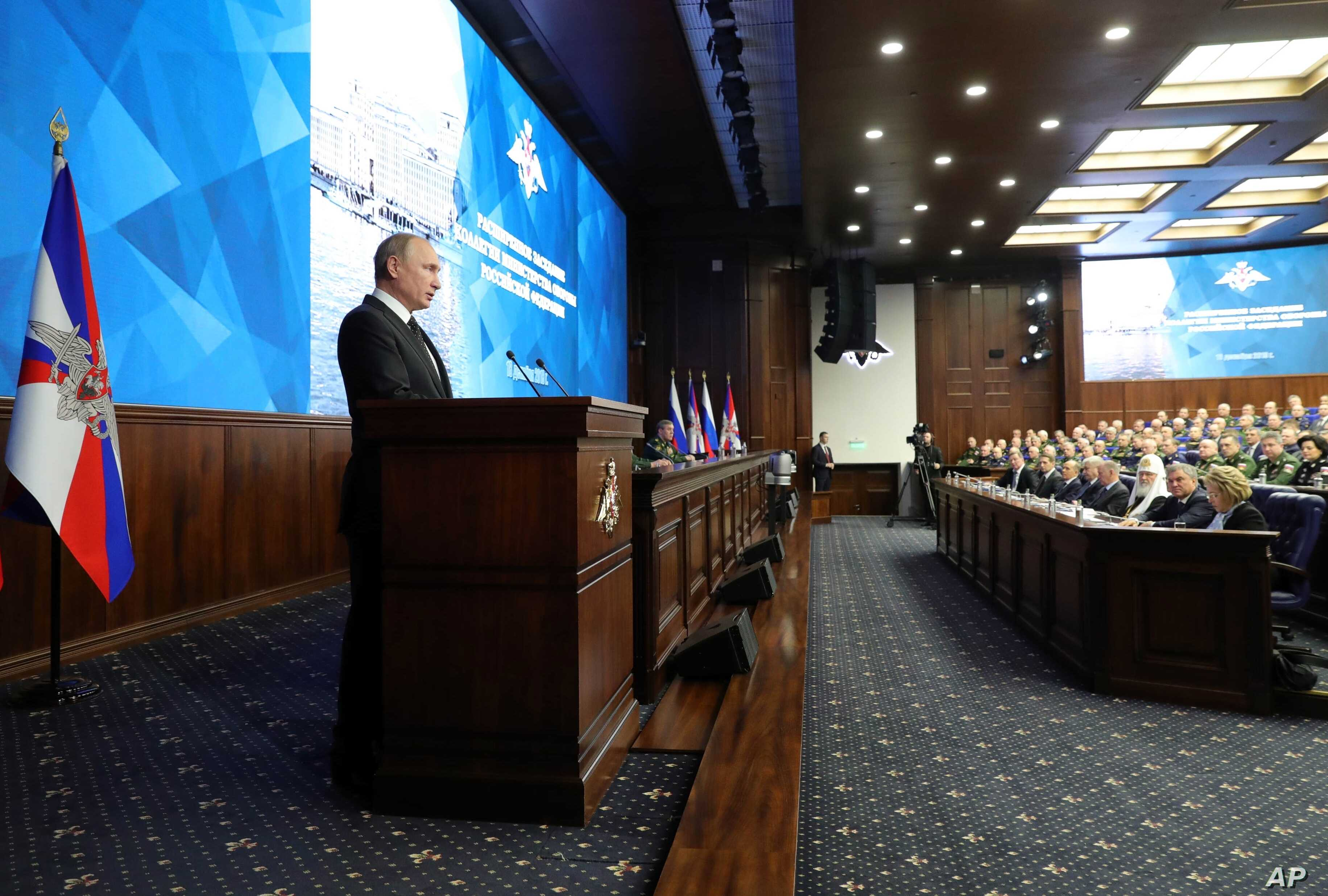 Russian President Vladimir Putin makes an address during a meeting in the Russian Defense Ministry's headquarters in Moscow, Russia, Dec. 18, 2018.