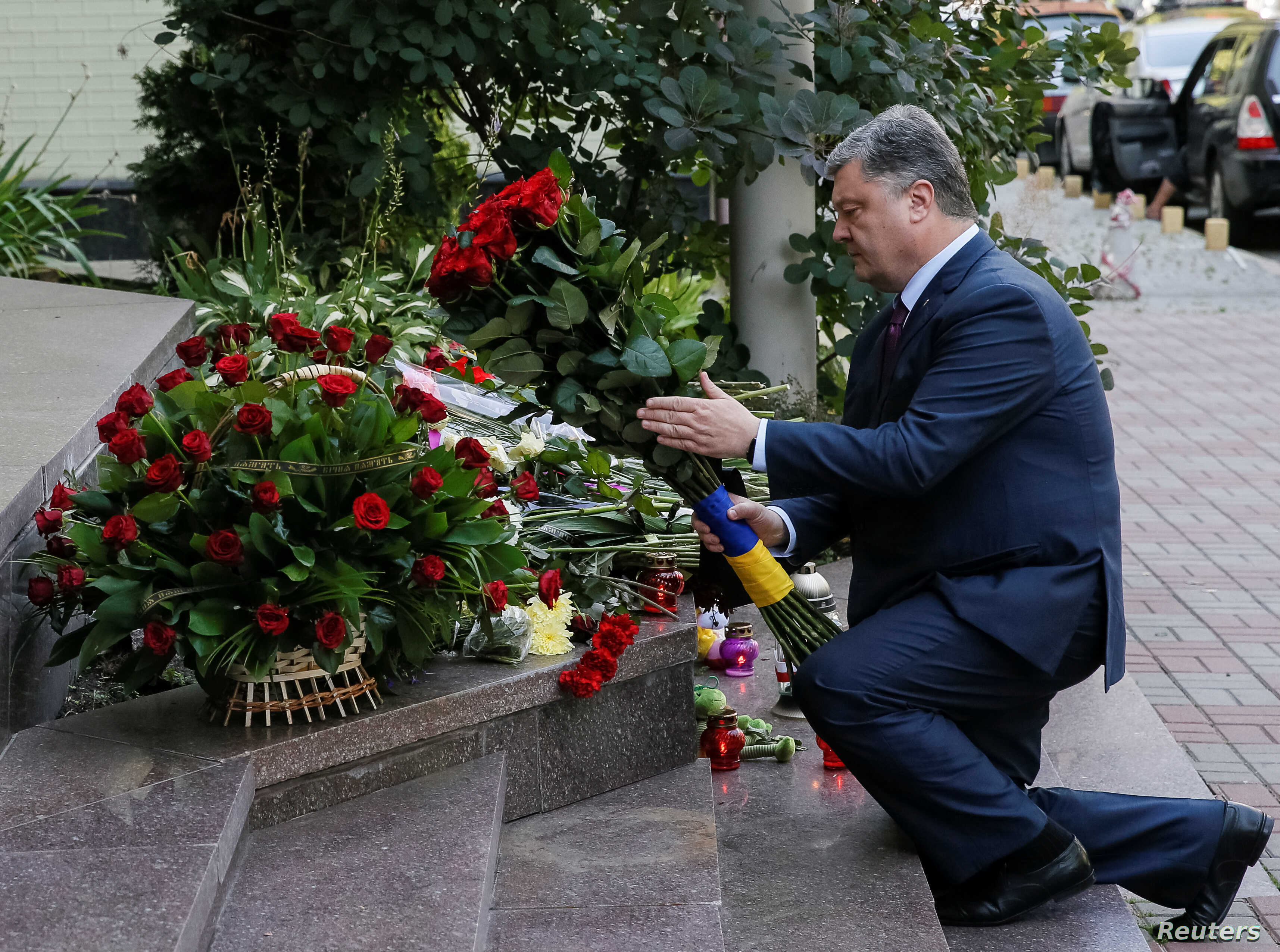 Ukraine's President Petro Poroshenko lays flowers to pay tribute to the victims of the Bastille Day truck attack in Nice, in front of the French embassy in Kiev, Ukraine, July 15, 2016.
