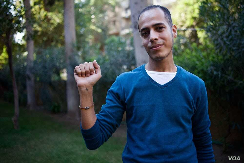 Former Christian Milad Soliman says he became an atheist after he entered university. He still has a small tattooed Coptic cross on his wrist, Oct. 25, 2013, Cairo, Egypt. Yuli Weeks for VOA