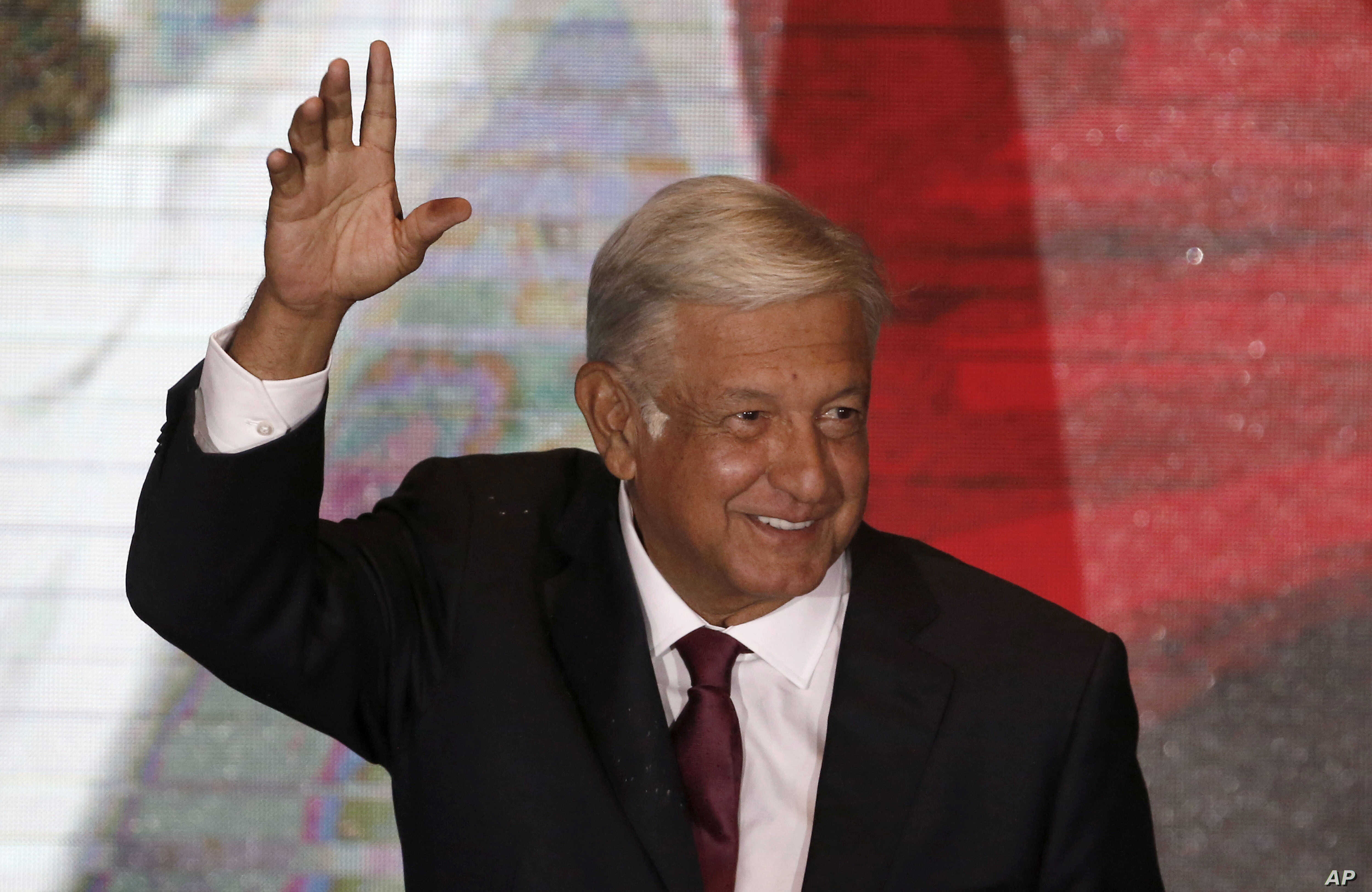 Presidential candidate Andres Manuel Lopez Obrador waves to supporters as he gives his first victory speech from his campaign headquarters in Mexico City, July 1, 2018.