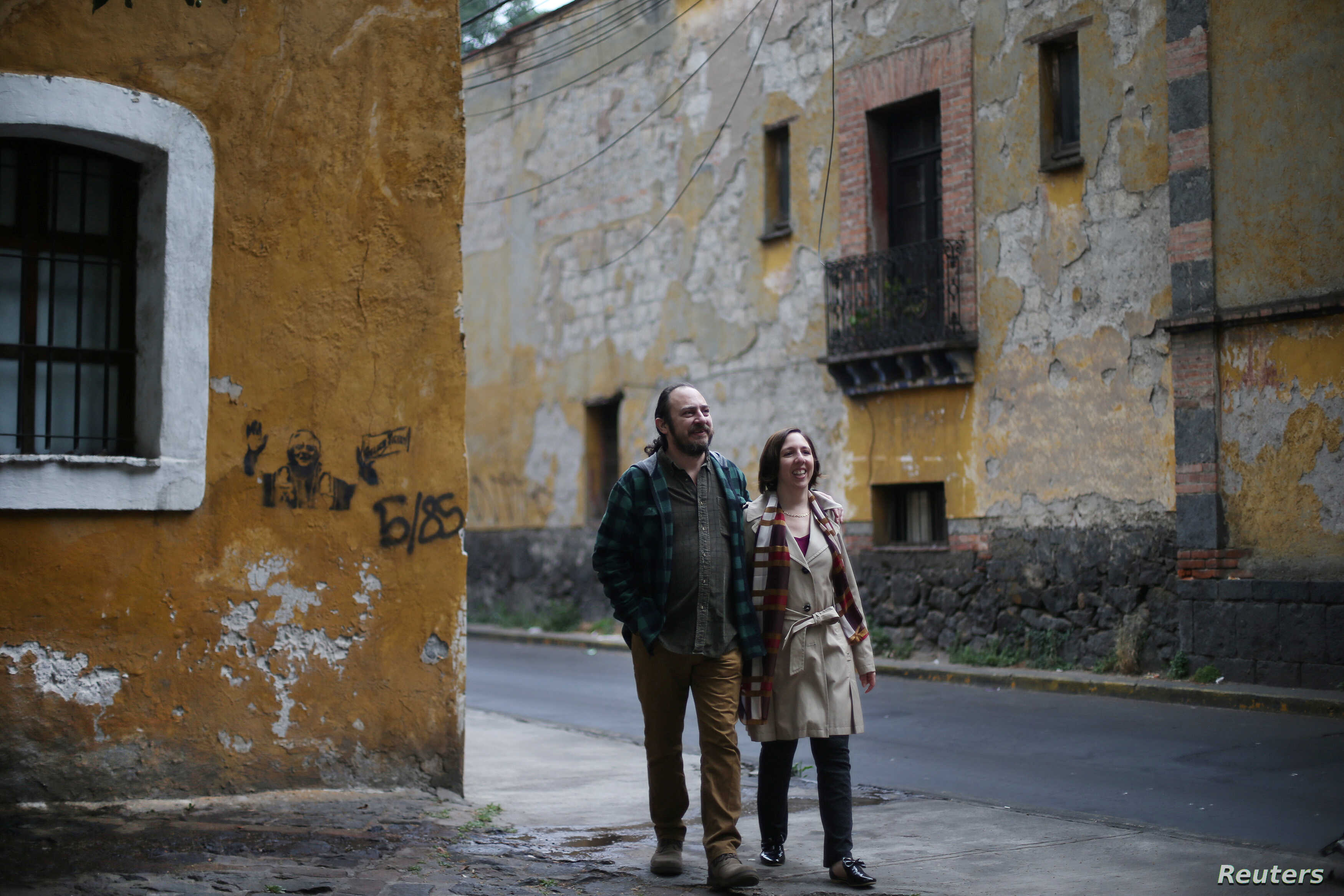 Alejandra, 44, an education policy consultant and Razhy, 48, a journalist and a human rights activist, walk on a street in the Coyoacan neighborhood, in Mexico City, Mexico, Feb. 9, 2018. The couple met in Mexico City in 1998, after Razhy was kidnapp...