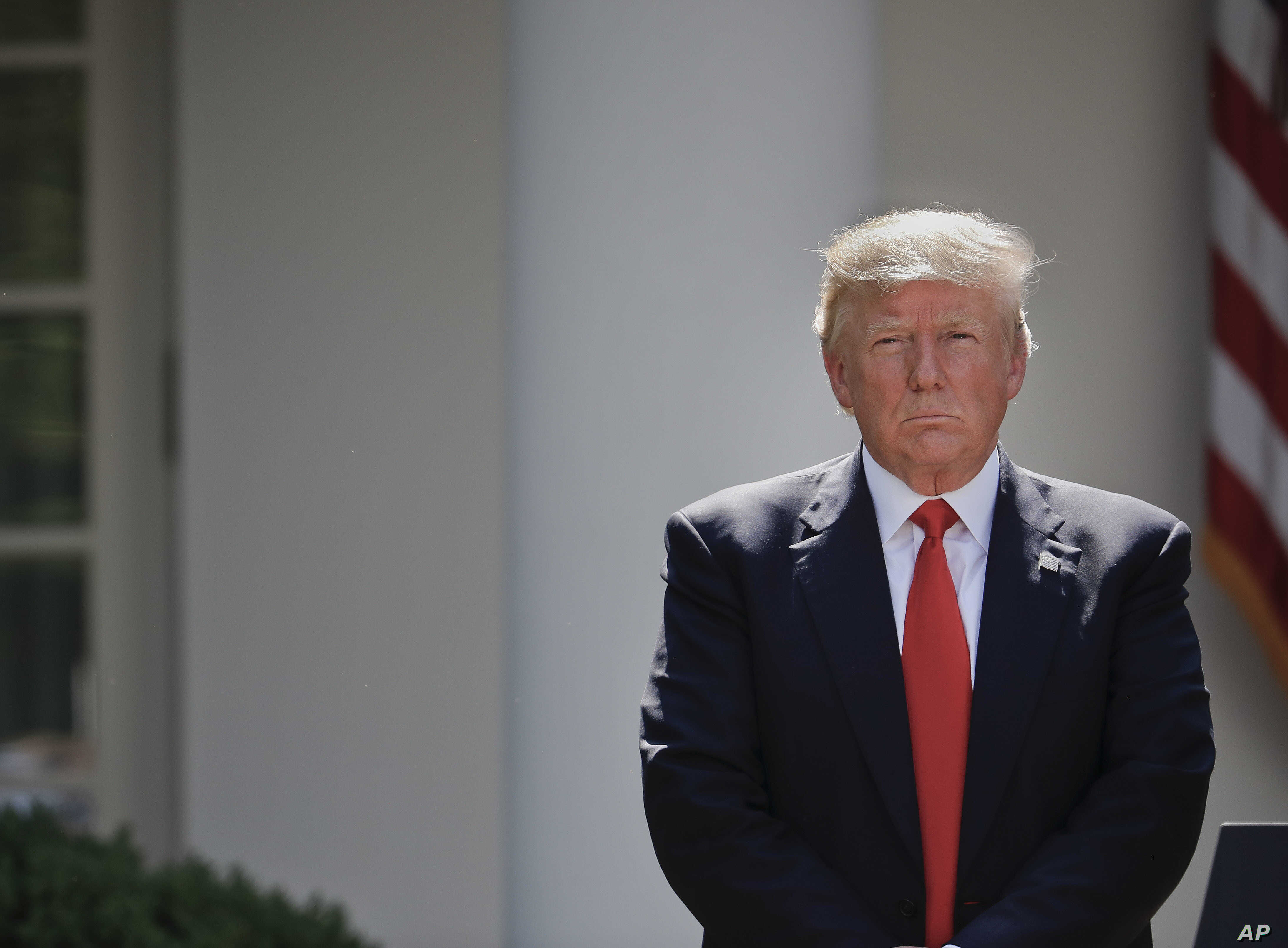 President Donald Trump stands next to the podium after speaking about the U.S. role in the Paris climate change accord in the Rose Garden of the White House in Washington, June 1, 2017.