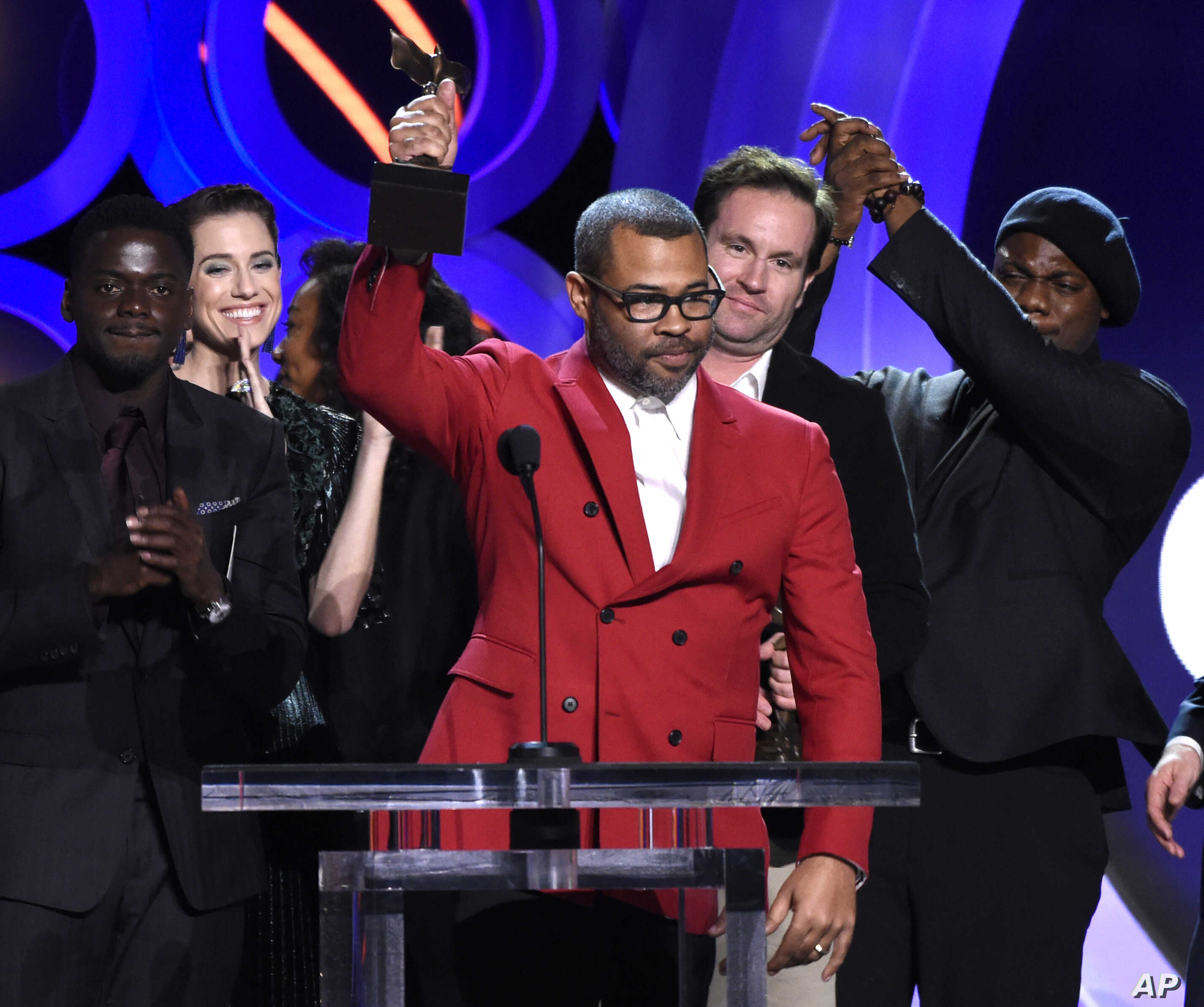 "Jordan Peele accepts the award for best feature for ""Get Out"" at the 33rd Film Independent Spirit Awards, March 3, 2018, in Santa Monica, Calif."