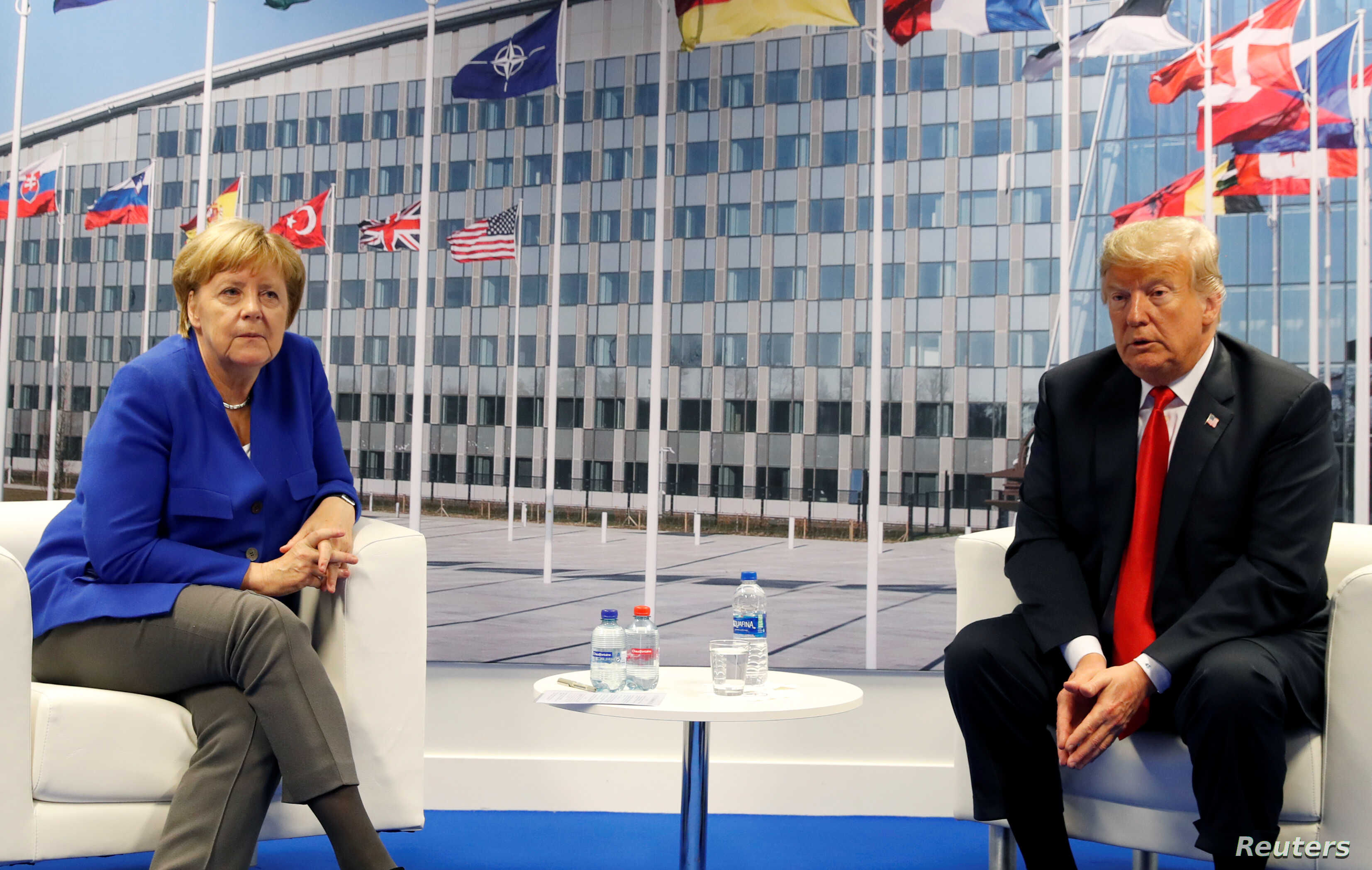 U.S. President Donald Trump meets with German Chancellor Angela Merkel during the NATO summit in Brussels, Belgium, July 11, 2018.