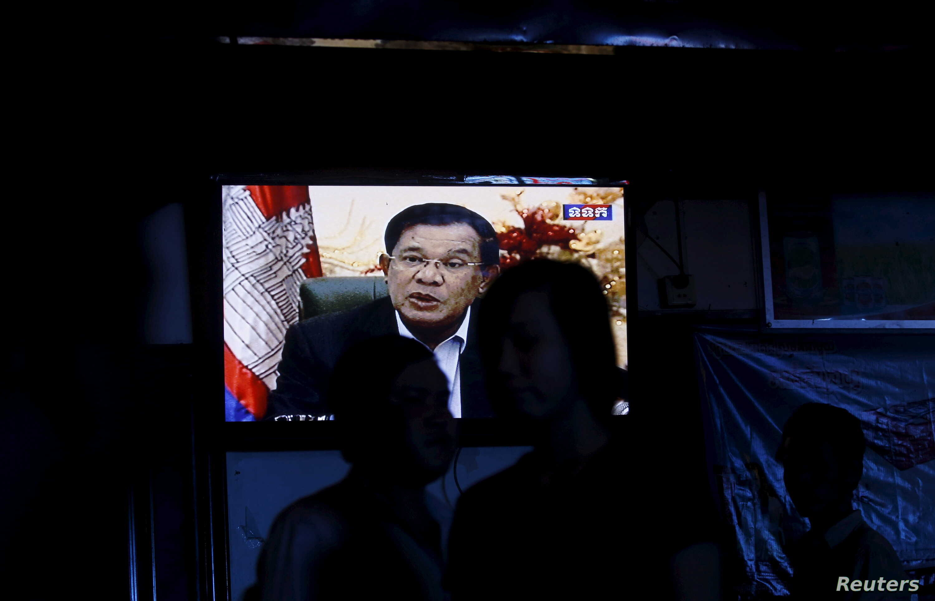 Cambodia's Prime Minister Hun Sen is seen on a television as he delivers a speech, at a restaurant in central Phnom Penh, Oct. 28, 2015.