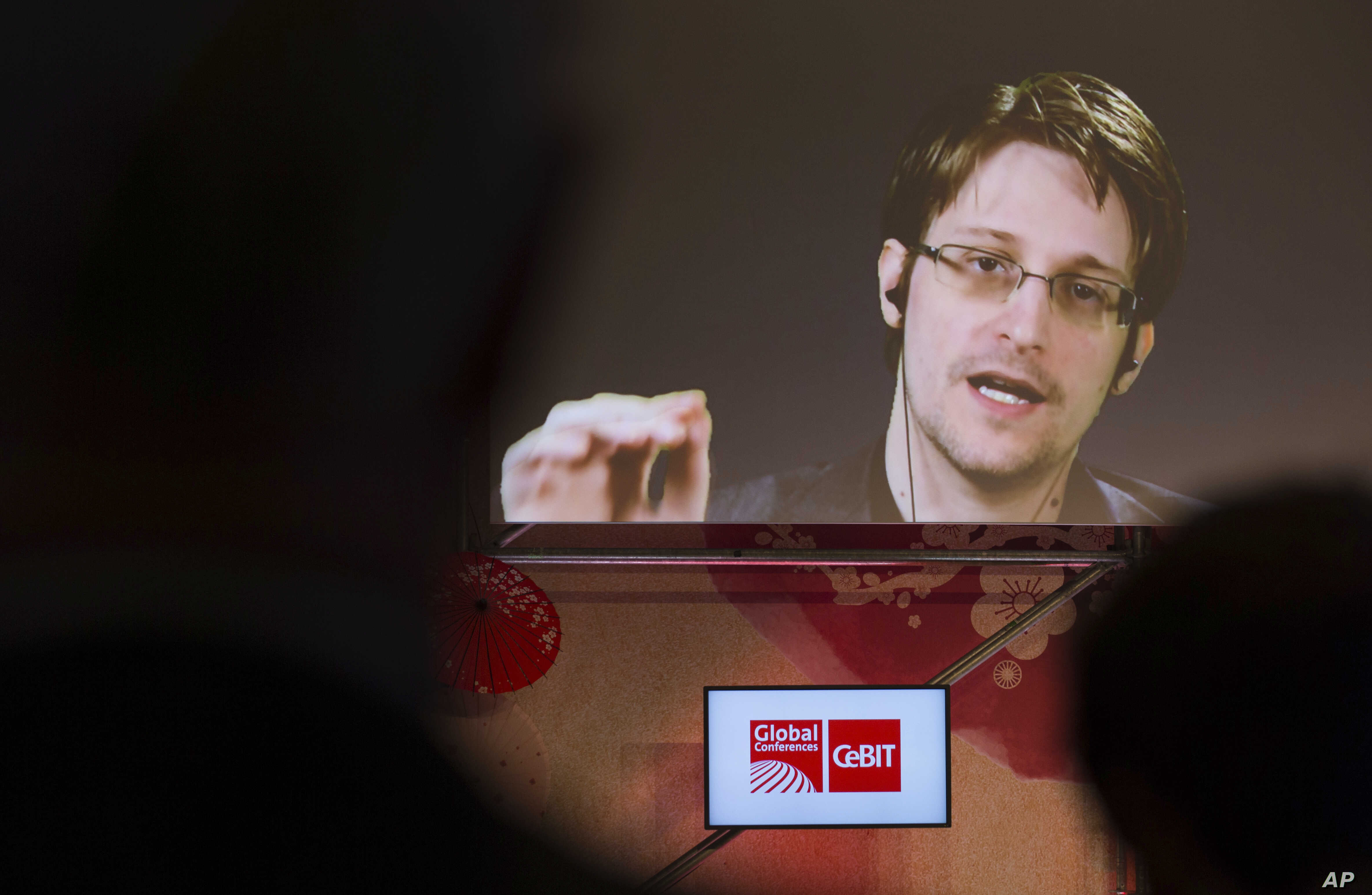 FILE - Edward Snowden, a former CIA worker before turning whistleblower, speaks via satellite at the IT fair CeBIT in Hanover, Germany, March 21,  2017.