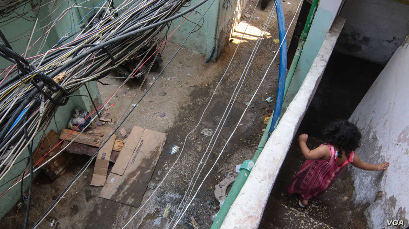 The cables just outside Ahmad's home, close to where he died in 2015. (J. Owens/VOA)