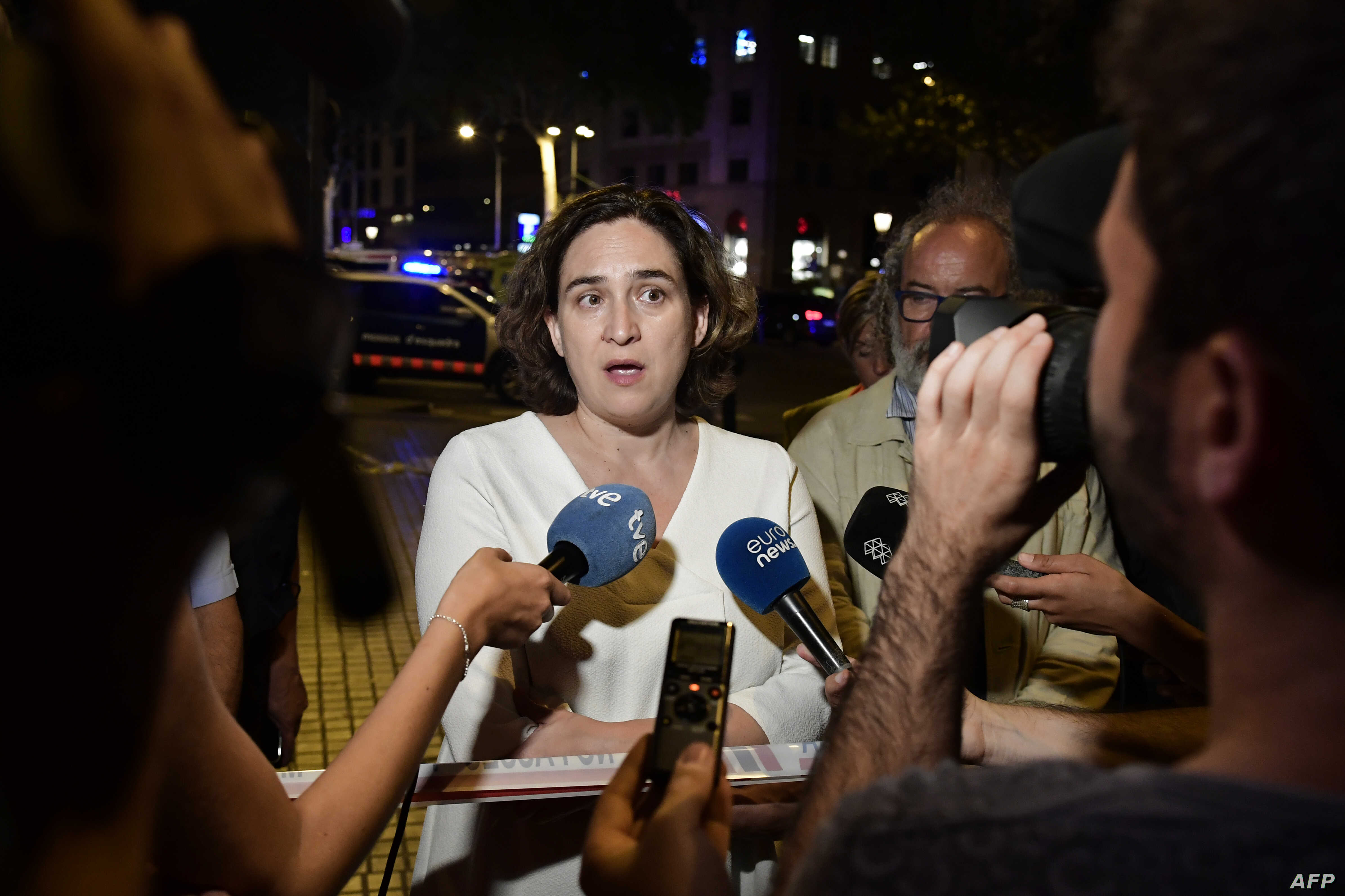 Barcelona's Mayor Ada Colau speaks to the press on the Rambla boulevard after a van ploughed into the crowd, killing at least 13 people and injuring around 100 others on the Rambla in Barcelona, Aug. 17, 2017.