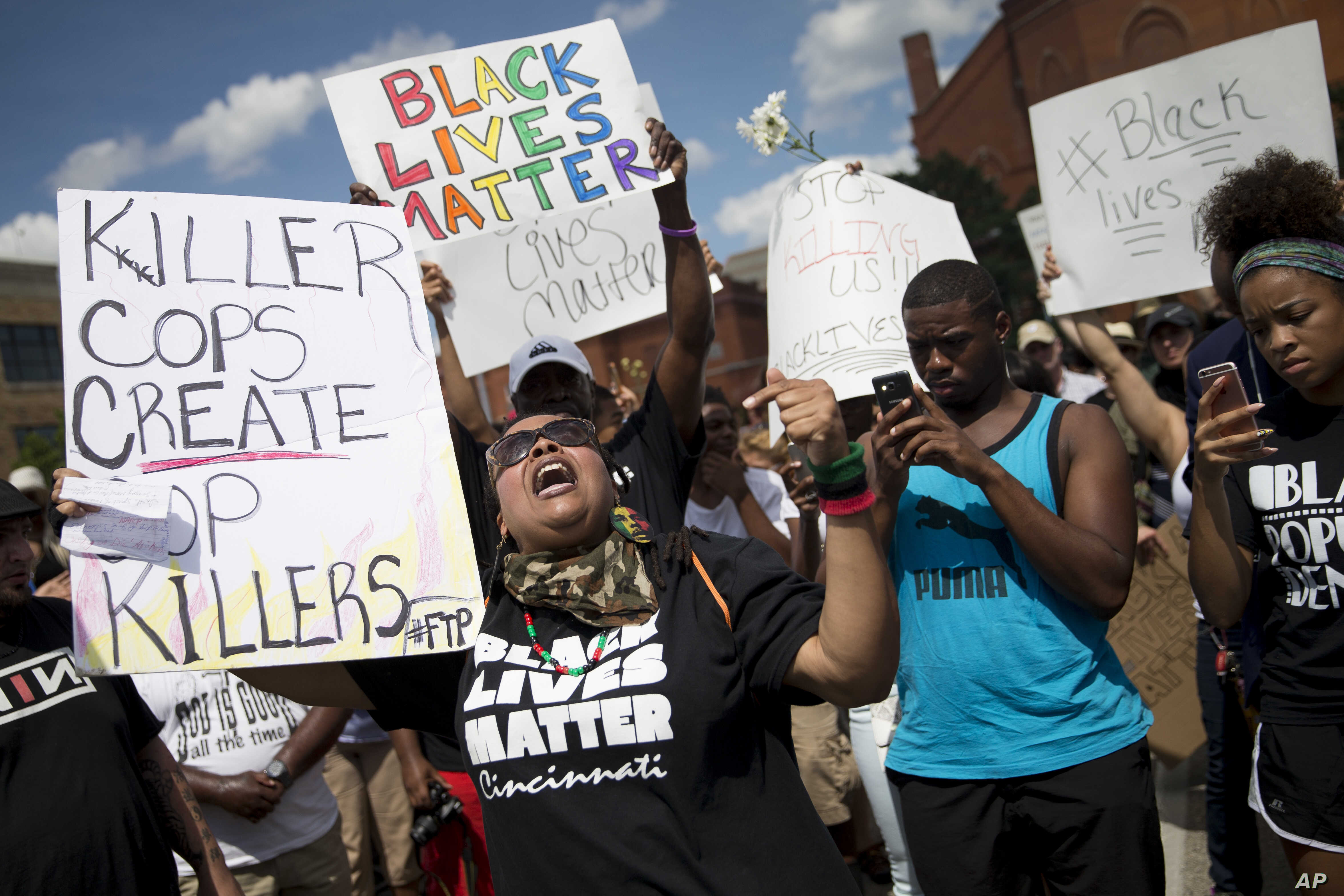 Protestors rally during a Black Lives Matter demonstration, July 10, 2016, in Cincinnati. More than a thousand protested against the shootings of black men by police officers.