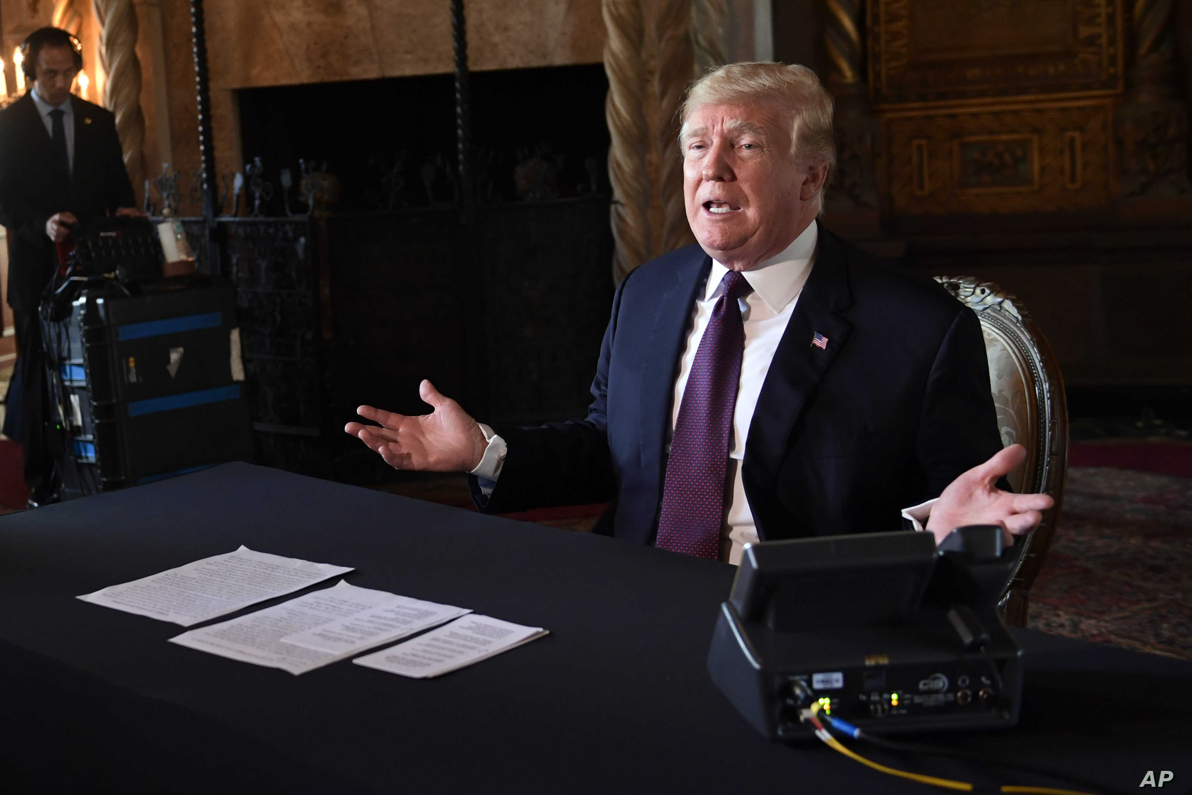 President Donald Trump speaks to reporters following his teleconference with troops from his Mar-a-Lago estate in Palm Beach, Fla., Nov. 22, 2018.