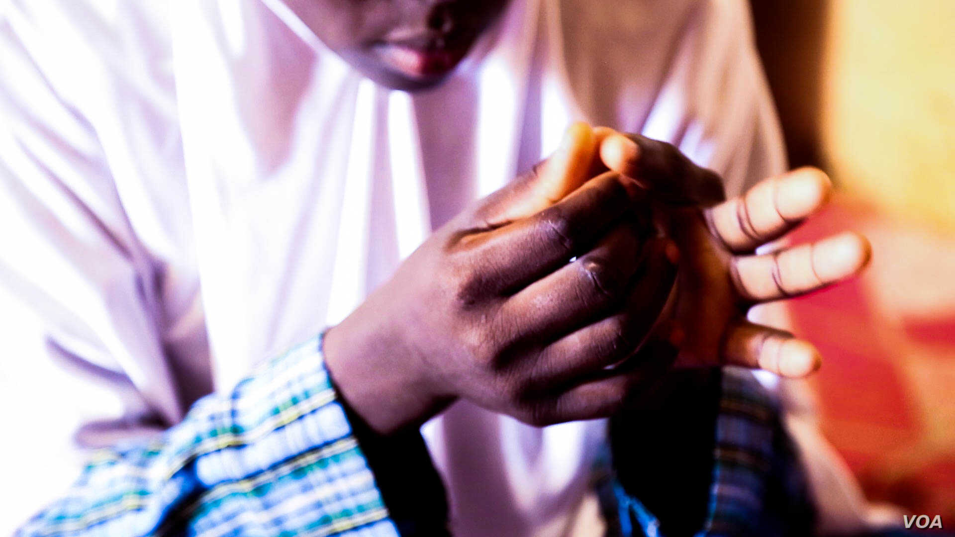 """""""I was being forced into an arranged marriage. That was why I ran away,"""" says 14-year-old Rahmatu. (C. Oduah/VOA)"""